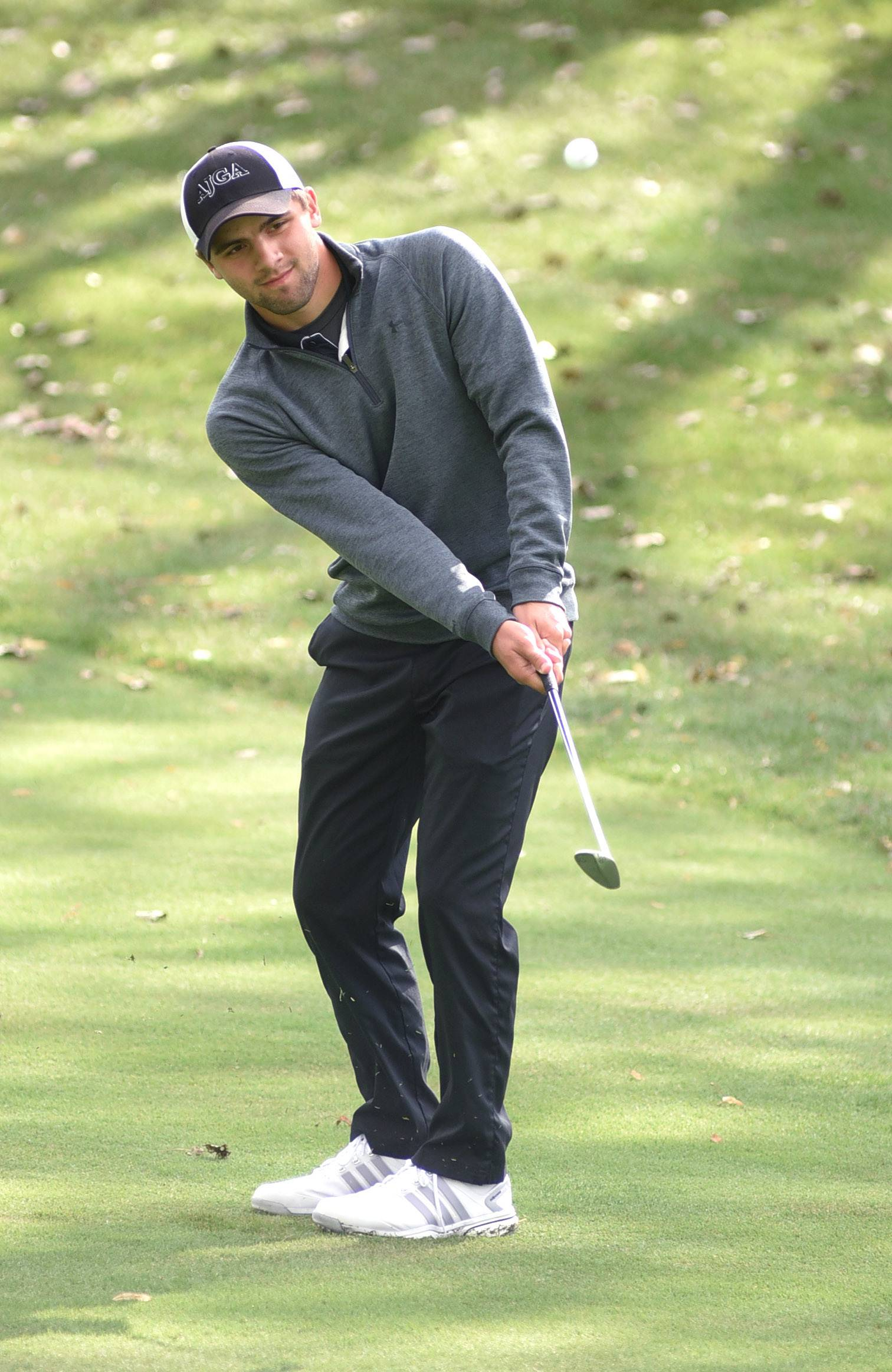 Jacobs' Justin Lenzini chips his ball onto the green of the third hole at the Fox Valley Conference meet in Crystal Lake Thursday.