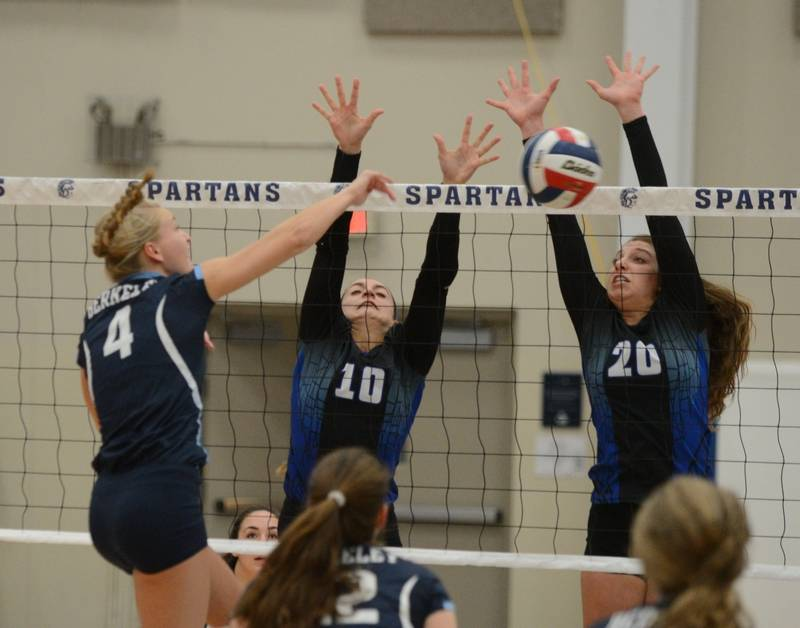 Sofia Florin of Berkeley hits a ball at Daniele Messa and Cat Wilson during  the Berkeley