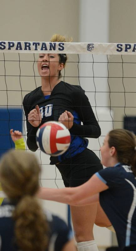 Molly Haggerty of St. Francis celebrates a good spike during the Berkeley  (Fla.