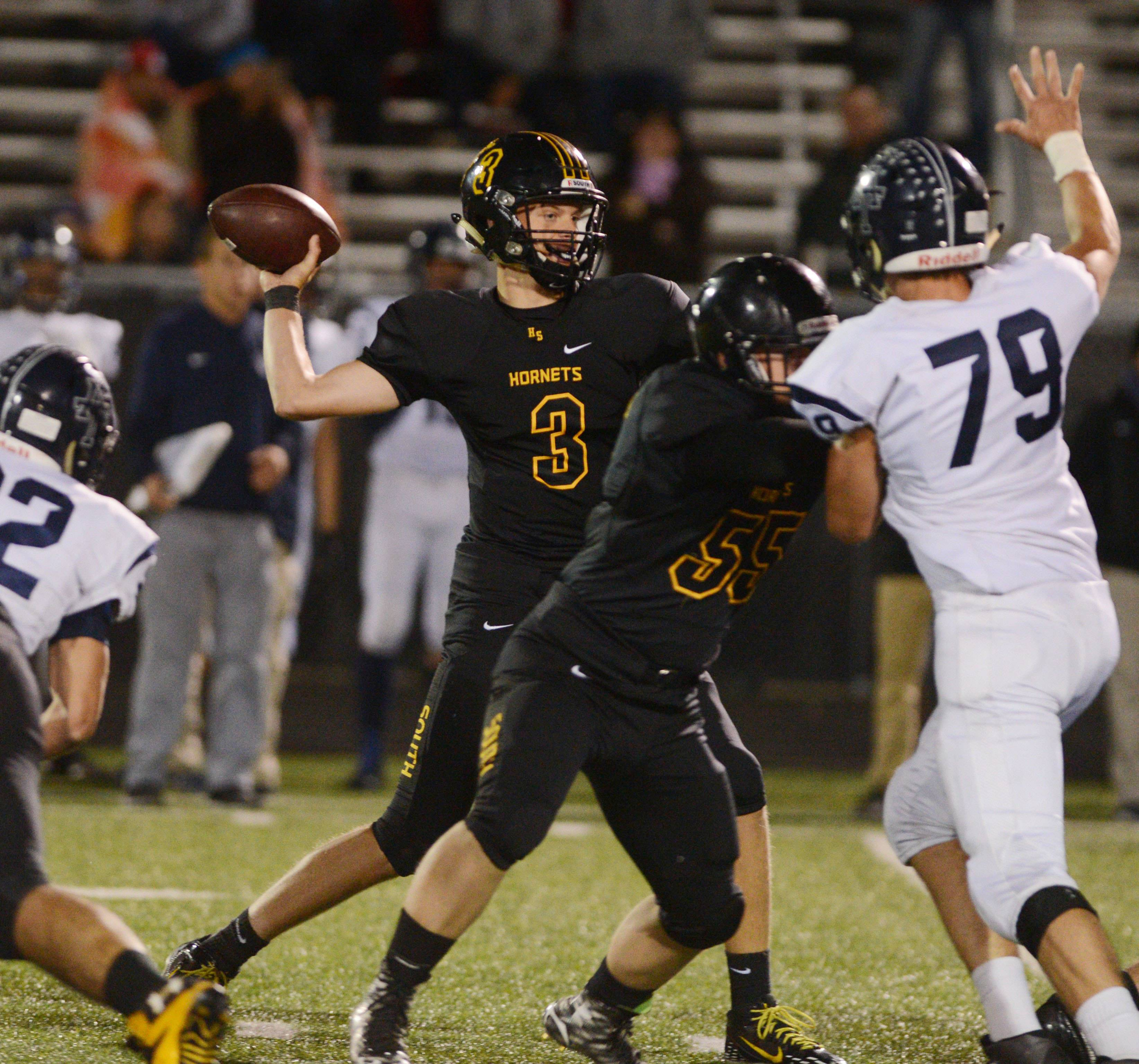 Sean McCormack of Hinsdale South looks for an open man during the Addison Trail at Hinsdale South football game Friday.