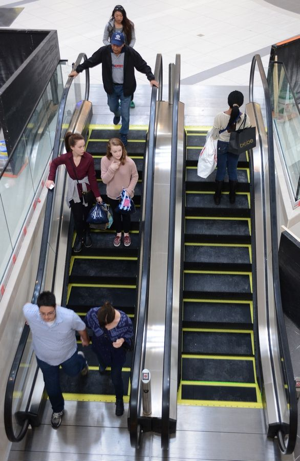 Patrons use the new mini-escalators minutes after their being placed into operation at Woodfield Mall in Schaumburg Thursday.