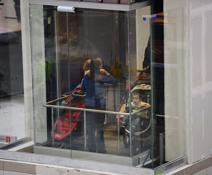 Patrons use the new second elevator in the center court of Woodfield Mall in Schaumburg Thursday.