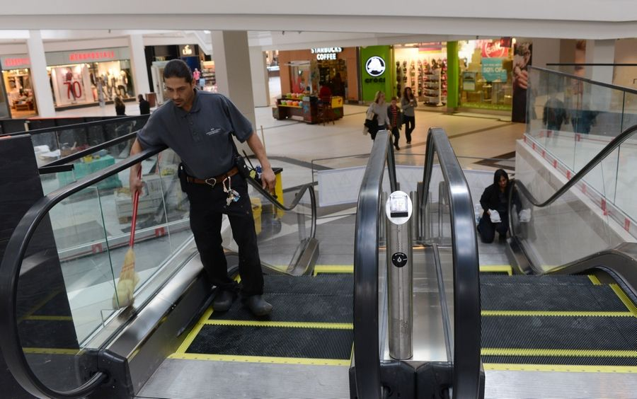 Roberto Rodriguez polishes the new mini-escalators just before they were placed into operation at Woodfield Mall in Schaumburg Thursday.