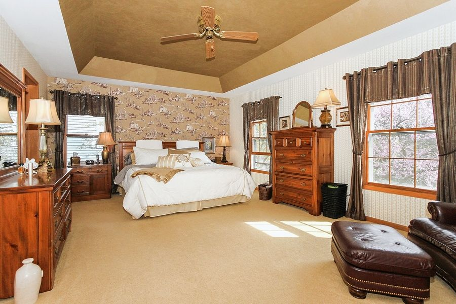 The master bedroom features a tray ceiling.