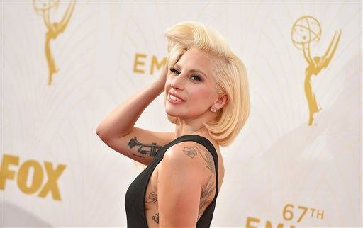 FILE - In this Sept. 20, 2015 file photo, Lady Gaga arrives at the 67th Primetime Emmy Awards at the Microsoft Theater in Los Angeles. Lady Gaga's first producer and former boyfriend has been given a new trial after a judge overturned an order that he pay $7.3 million to the Hollywood songwriter who discovered her. U.S. District Court Judge Jose Linares ordered the new trial for Rob Fusari on Sept. 3, but the ruling wasn't unsealed until Wednesday, Sept. 30, 2015. (Photo by Jordan Strauss/Invision/AP)