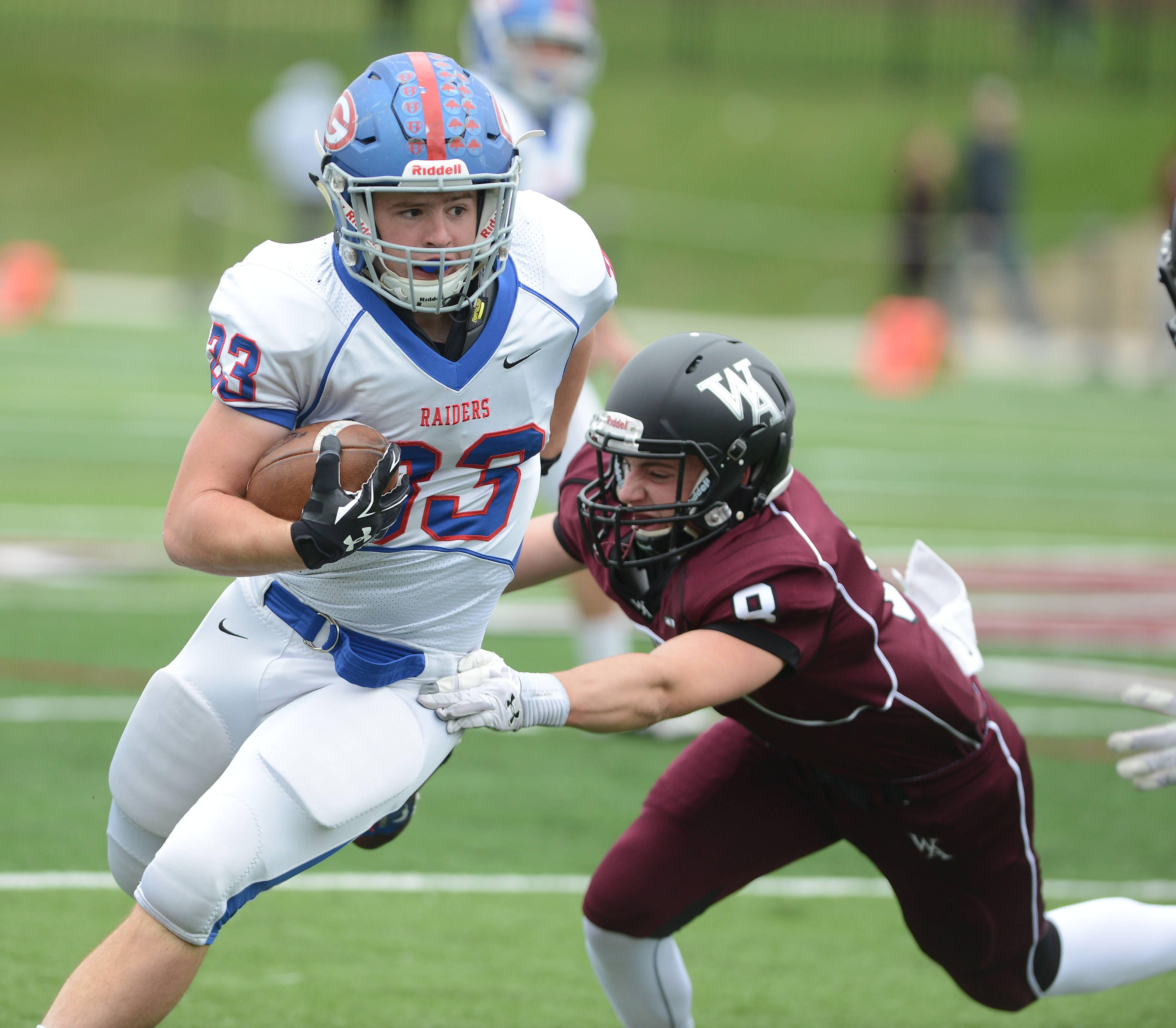 Sean Cooke of Glenbard South out runs Kordell Bowling of Wheaton Academy during the Glenbard South at Wheaton Academy football game Saturday.