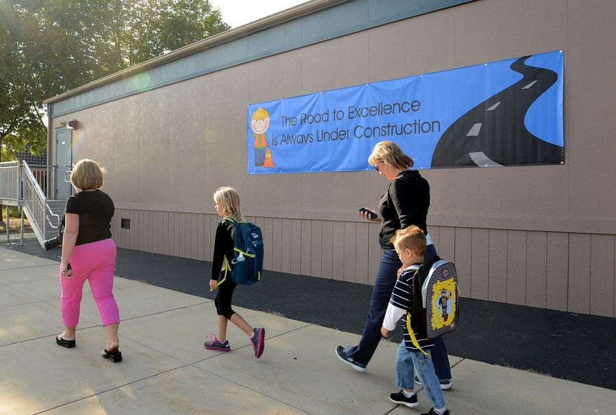 A mobile classroom outside of Ivy Hill Elementary School on the first day of school. Ivy Hill will be getting 10 new classrooms, while Olive-Mary Stitt School will get five. Both District 25 schools will get larger, air-conditioned gyms and larger common areas.