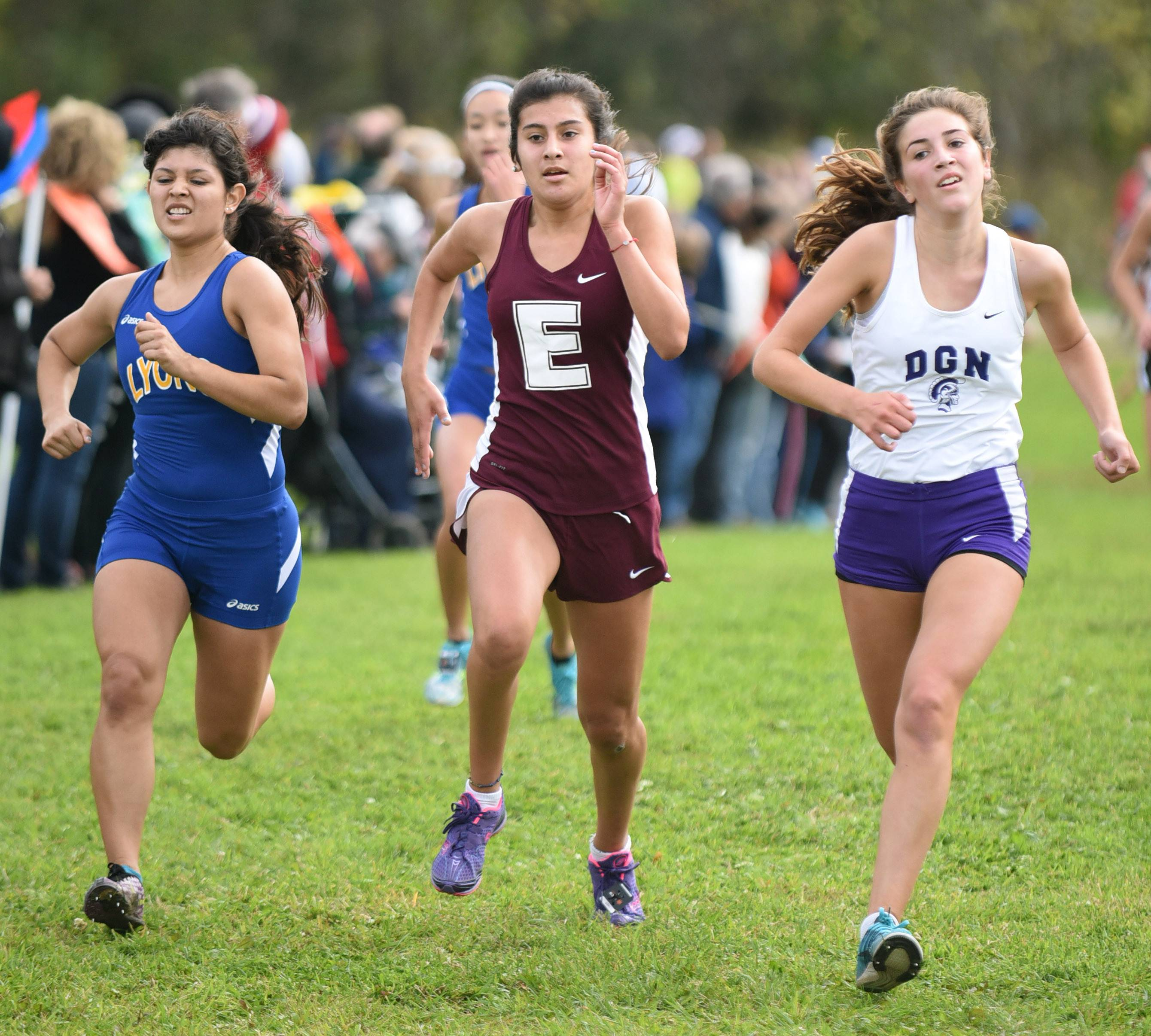 Elgin's Kasey Moreno sprints to the finish line in the girls varsity run at the St. Charles North cross country invitational at LeRoy Oakes Saturday.