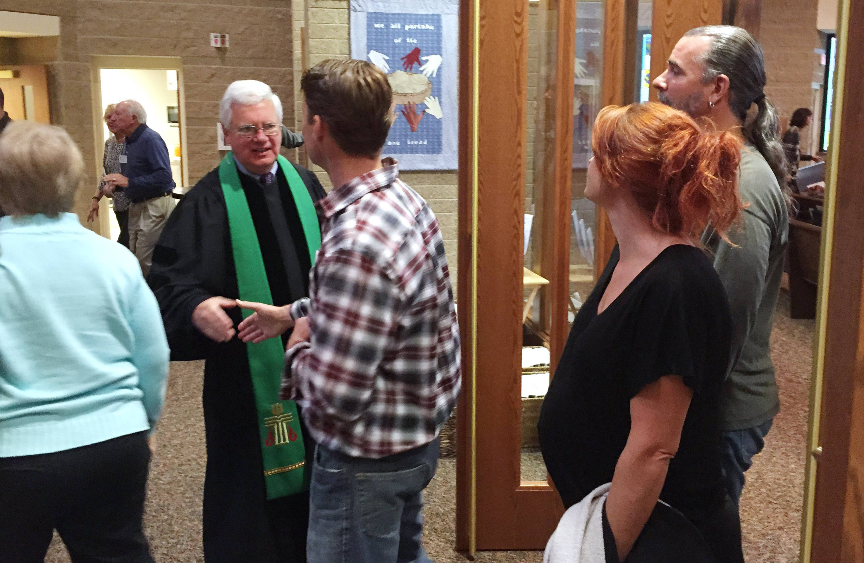 Wildwood Presbytarian Church near Grayslake did its best to return to normal Sunday, the day after a car plowed into the building. Here interim Pastor Bill Ingersol greets parishioners for their regular service.