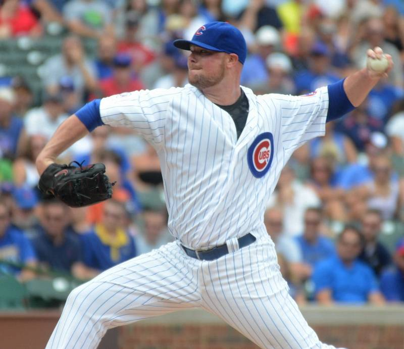 Jon Lester of the Cubs delivers during a game between the Chicago Cubs and Milwaukee Brewers at Wrigley Field in Chicago Thursday, Aug. 13. The Cubs won, 9-2.