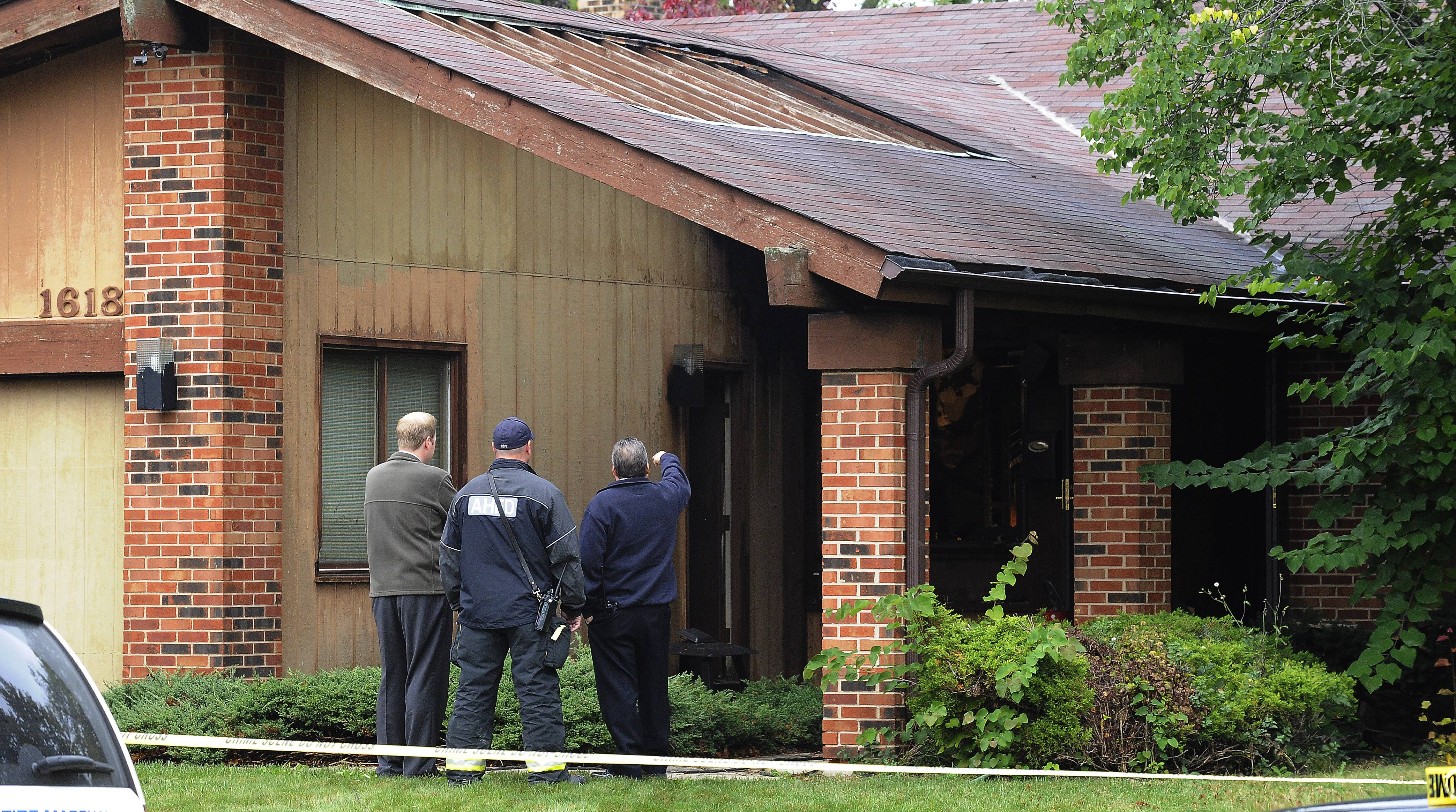 Fire officials at the scene of the fatal house fire in the 1600 block of Waverly in Arlington Heights.