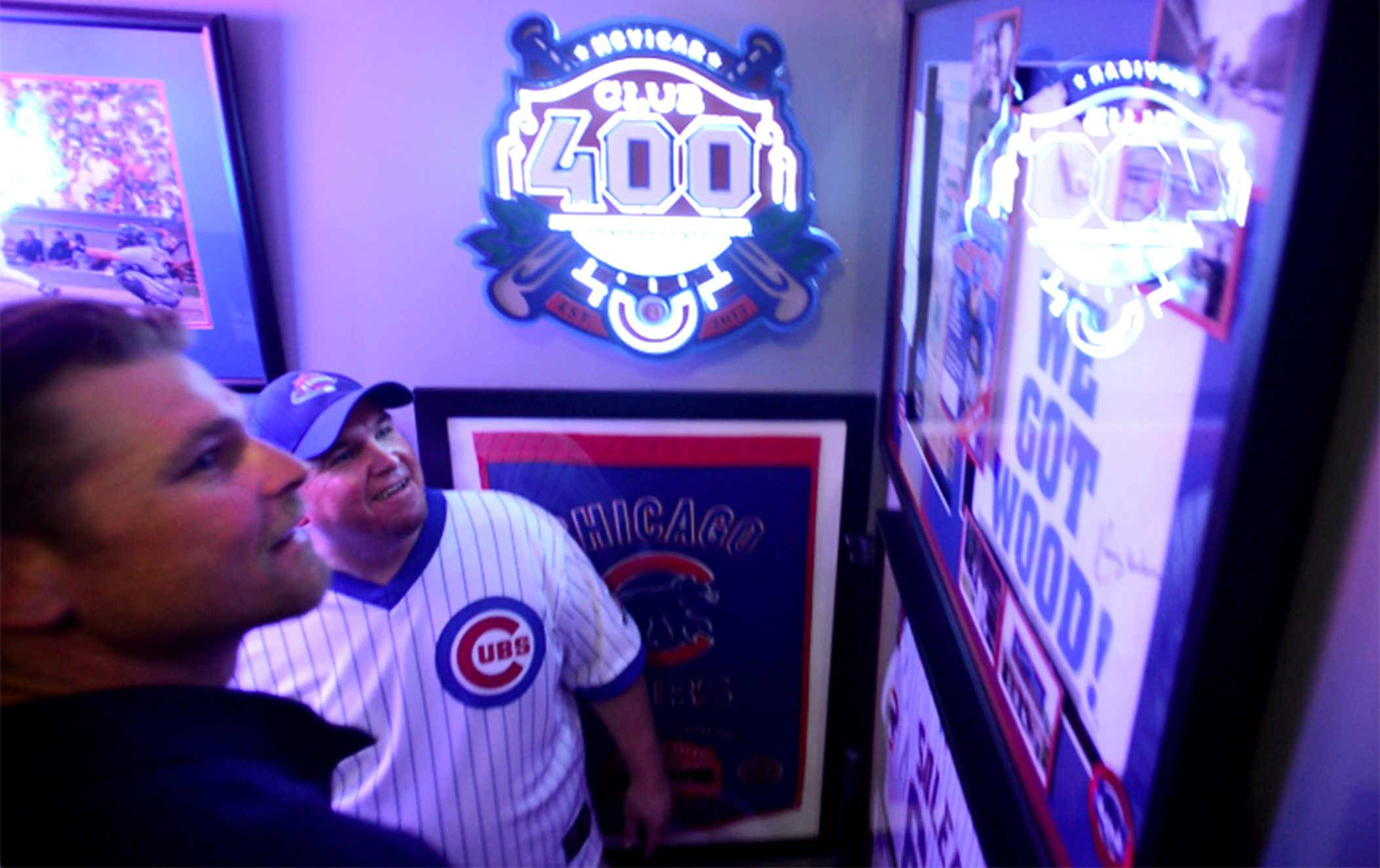 McVicar, center, introduces former Cubs pitcher Kerry Wood to a display of artifacts from Wood's playing days.
