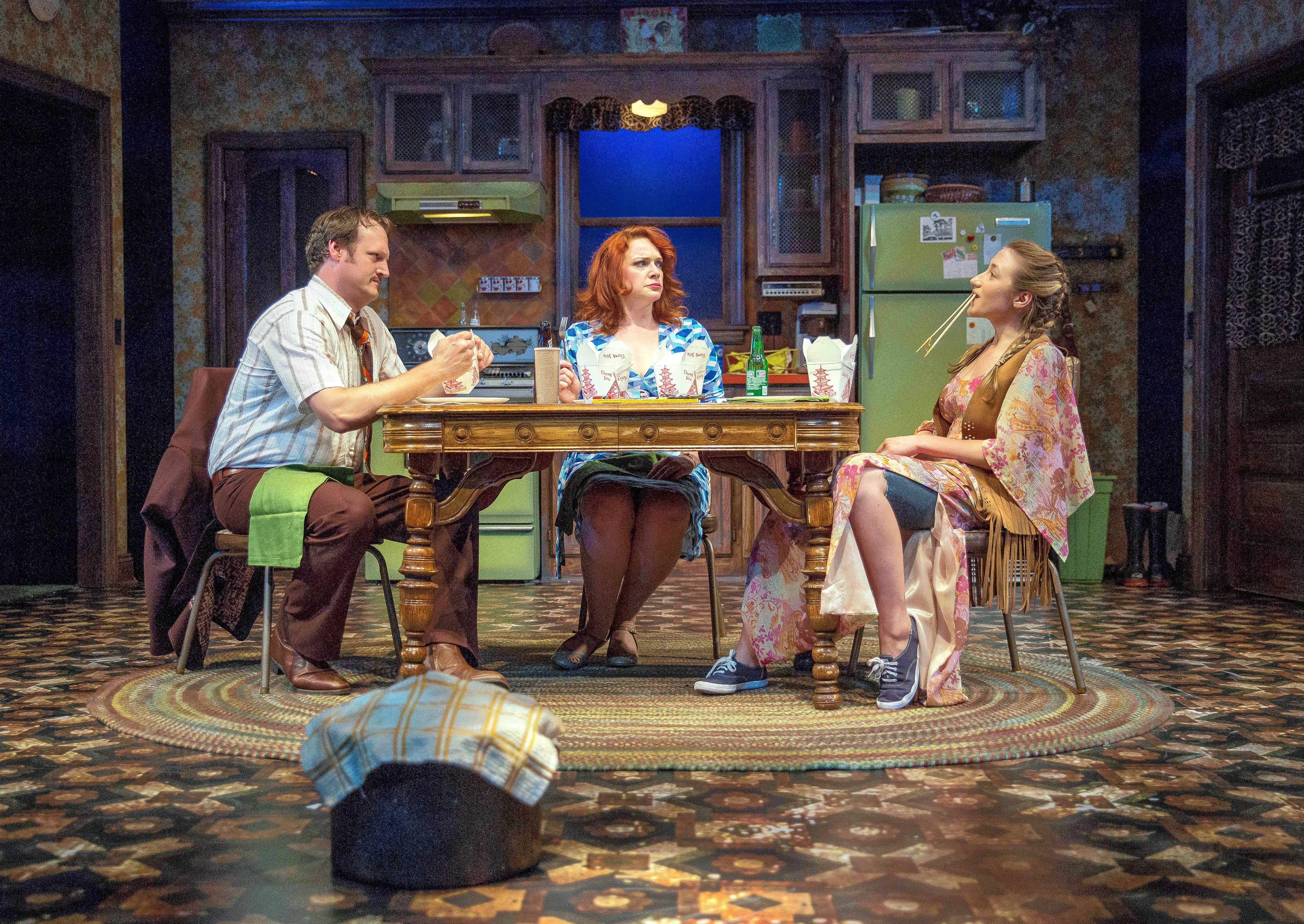 "Recent widower Arthur (Eric Slater) attempts to achieve some semblance of family with his teenage daughter Chris (Olivia Cygan), right, and his new girlfriend, Carol (Christina Hall), in Goodman Theatre's world premiere of Charise Castro Smith's thriller-horror-comedy ""Feathers and Teeth."""