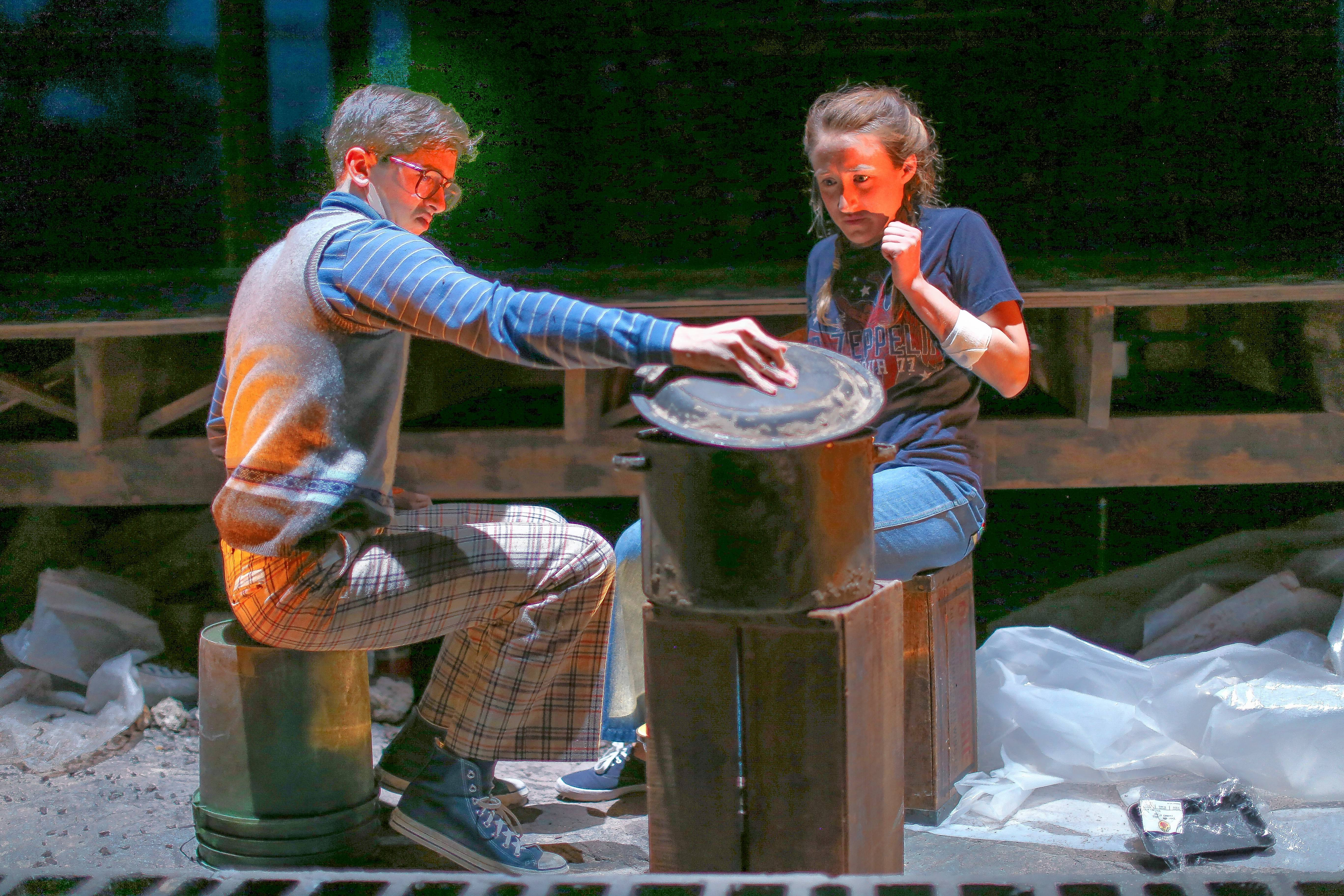 "Chris (Olivia Cygan) and her pal, Hugo (Jordan Brodess), tend to the creature in the pot in Charise Castro Smith's horror-comedy ""Feathers and Teeth"" at Goodman Theatre."
