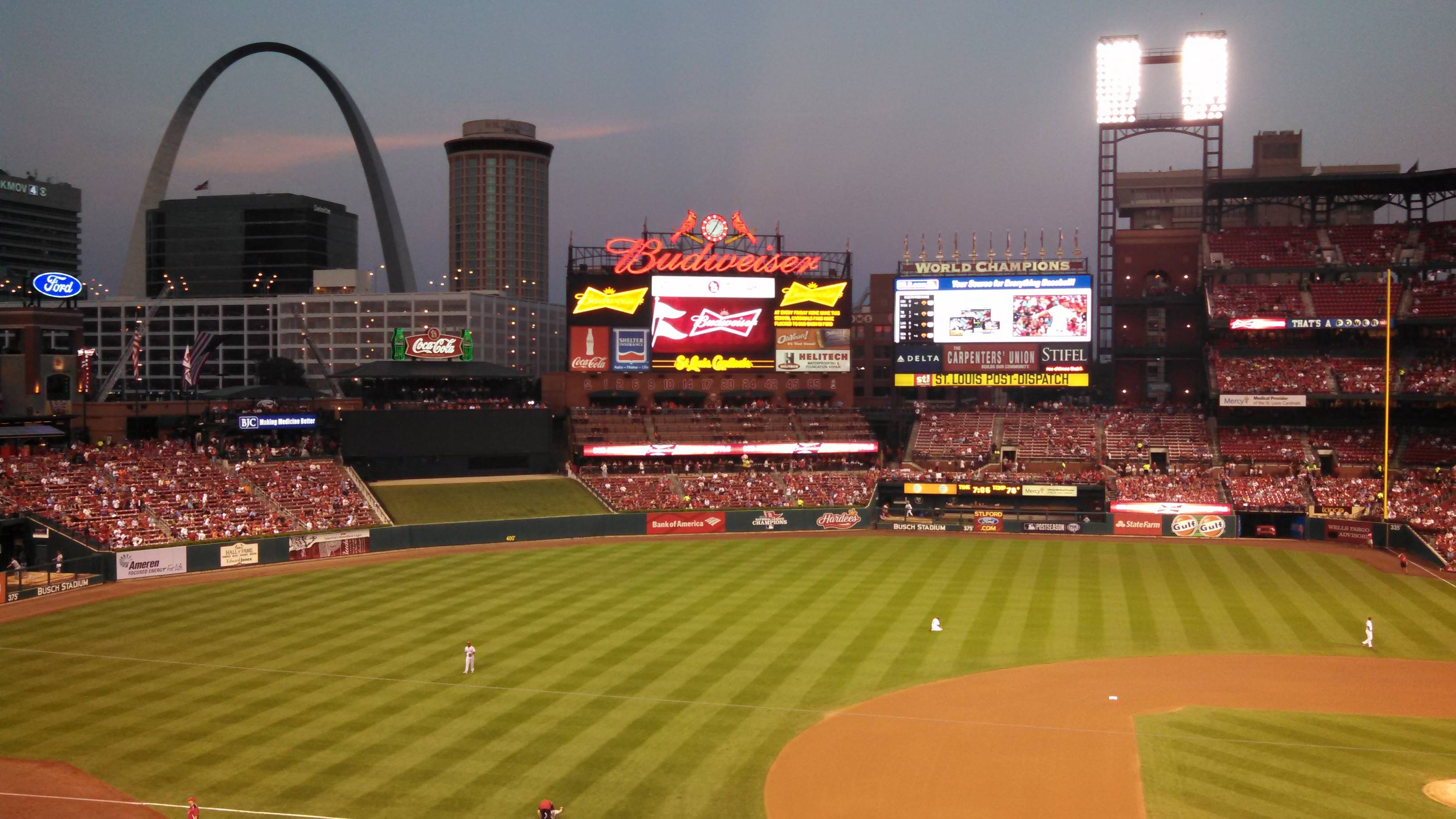 The Gateway Arch is the backdrop for a game at Busch Stadium in St. Louis.