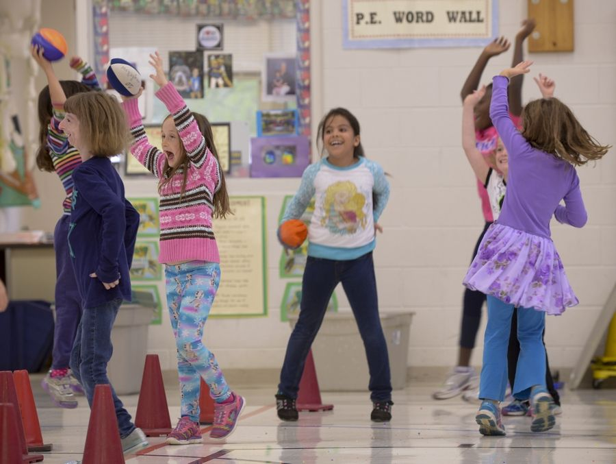 "Girls cheer during physical education class at Longfellow Elementary School in Wheaton, recently named a National Blue Ribbon School. ""Every day I step across that door, and I thank God that I have the privilege of being in this school because this school is a special place,"" their teacher Barb Williams says."
