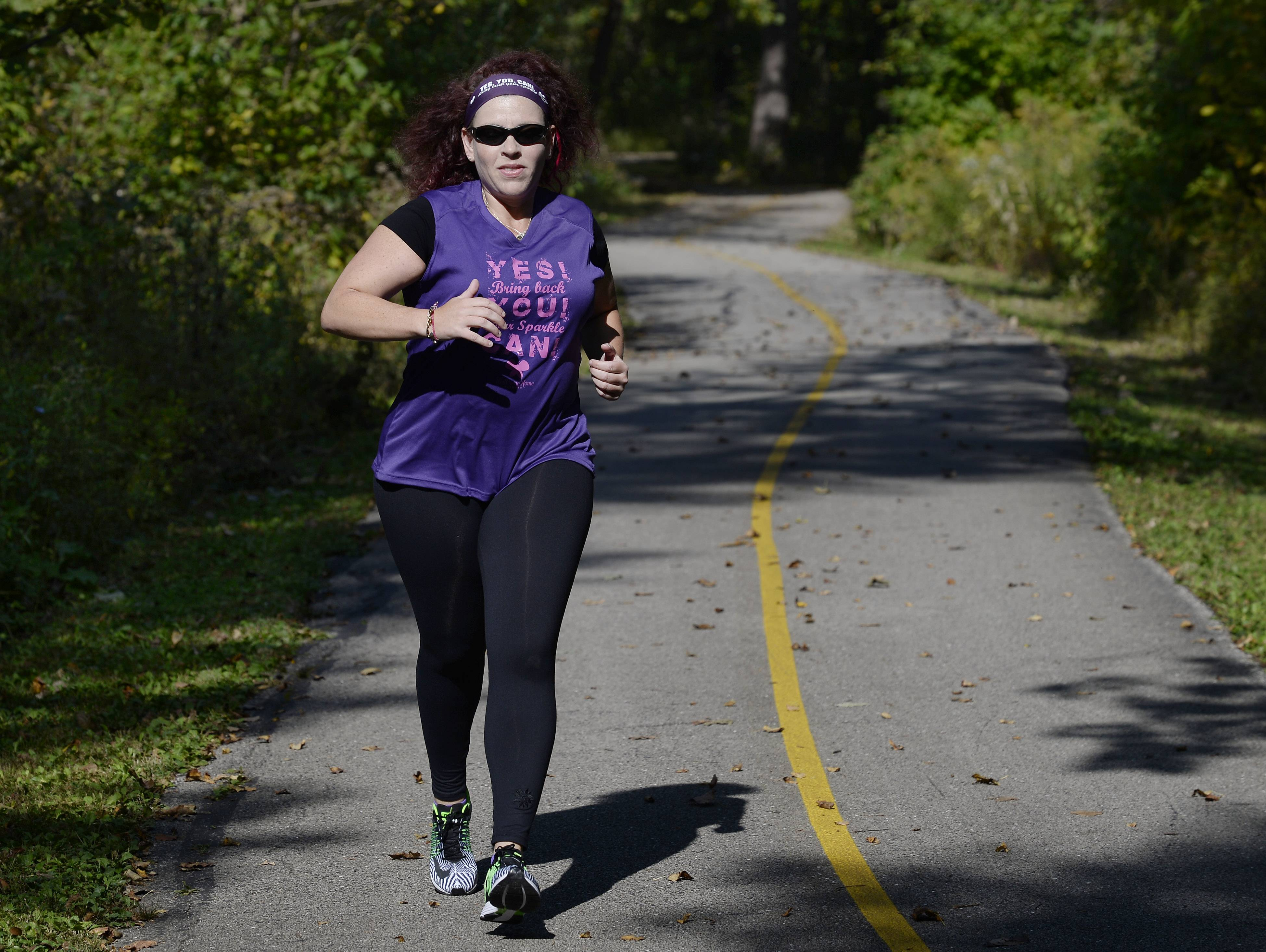 Michele Malo of Arlington Heights has been training at Busse Woods in Elk Grove Village for Sunday's Bank of America Chicago Marathon.