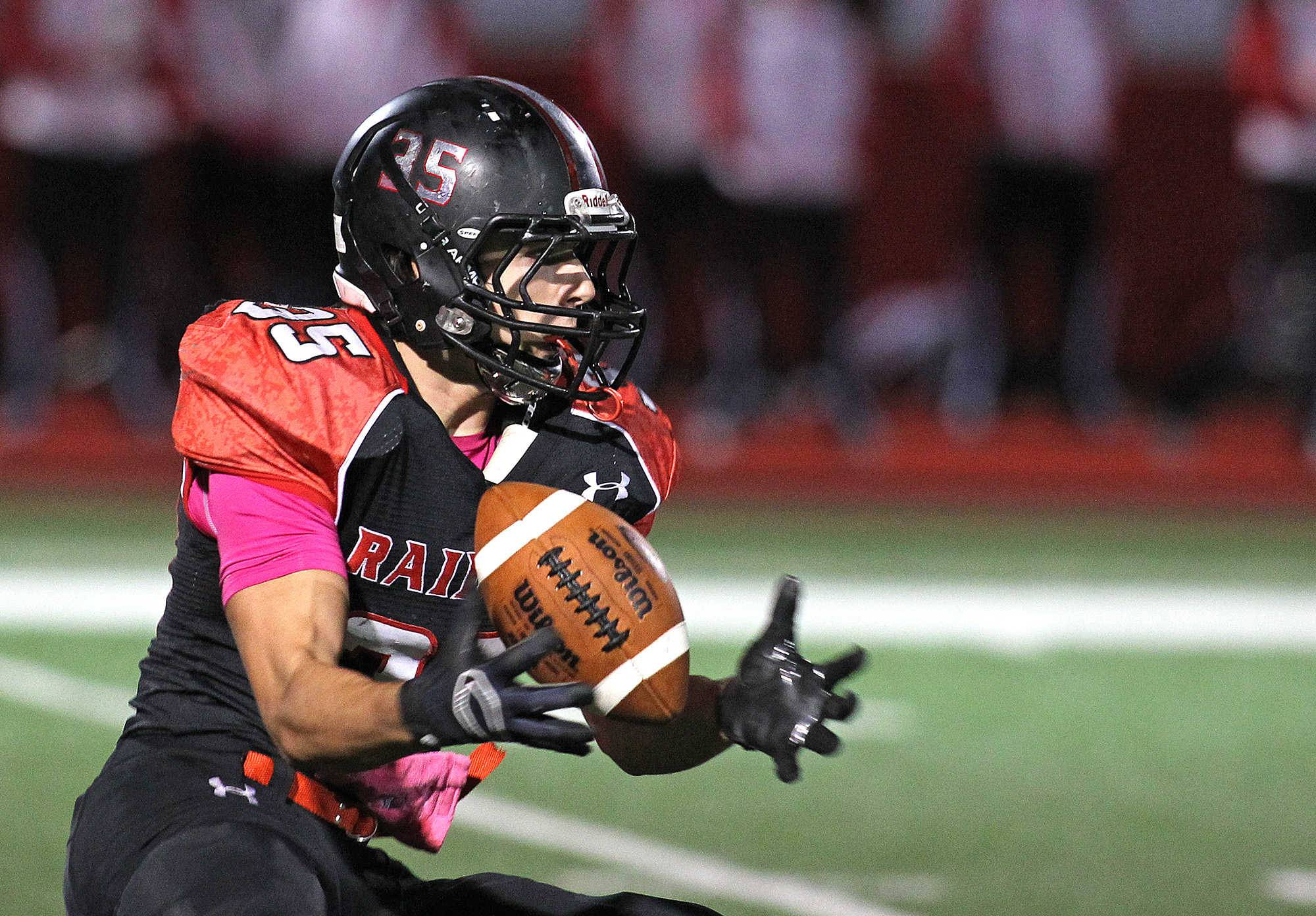 Huntley's Tim Ryan grabs a Crystal Lake South punt in the first half on Friday.