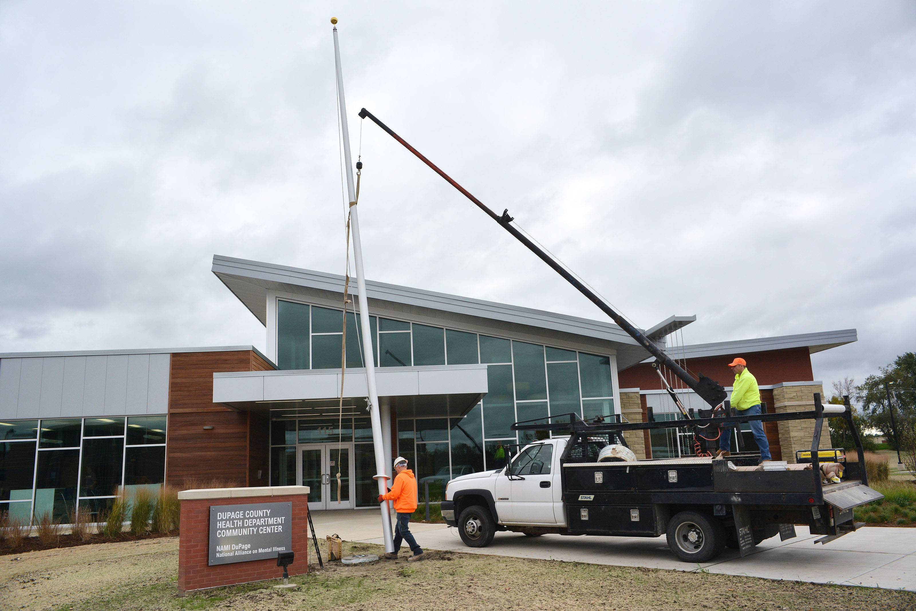 A flagpole was installed Friday outside the DuPage County Health Department's new community health center in Wheaton. The center's grand opening is scheduled for Oct. 15.