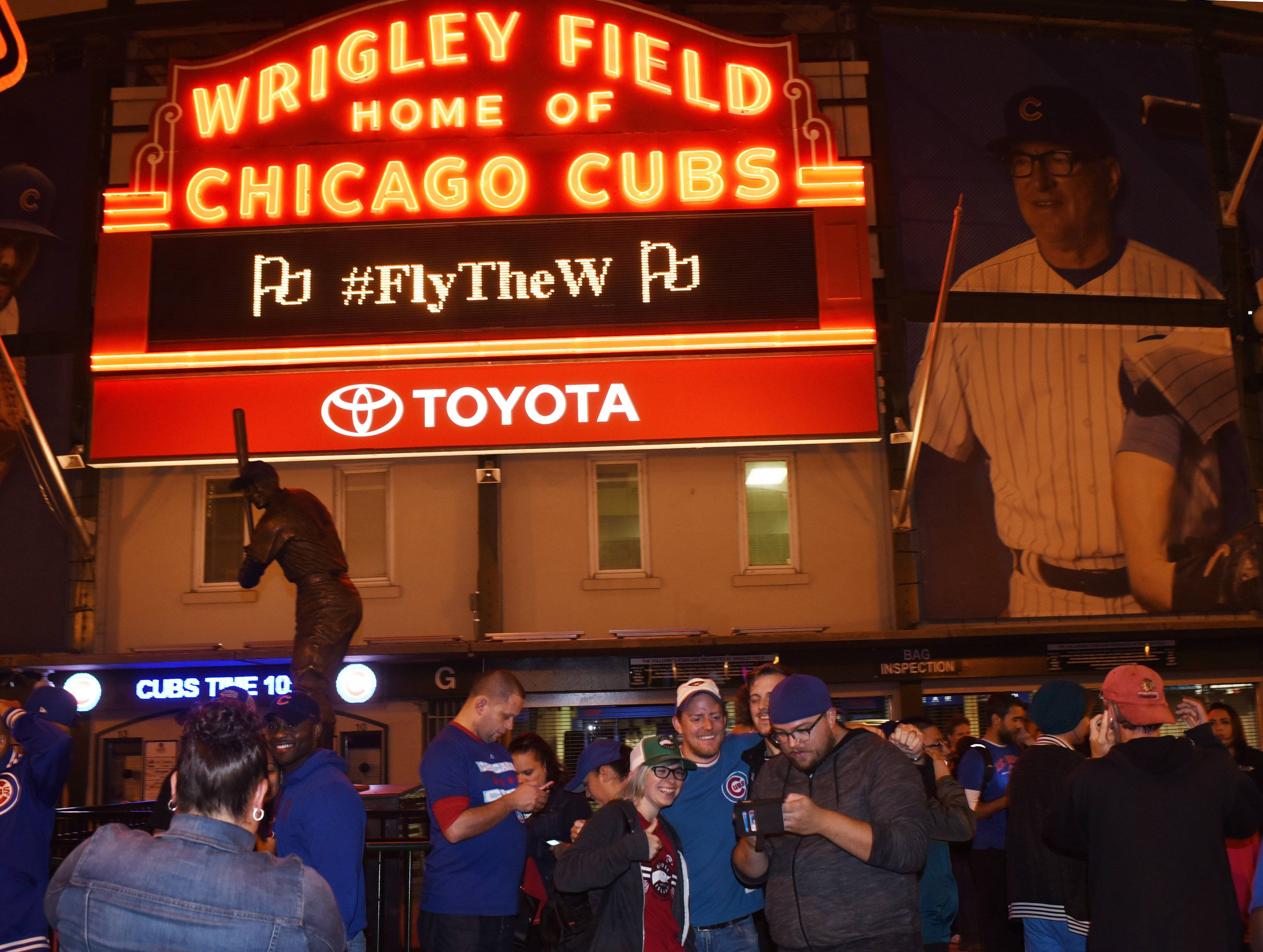 Fans celebrate outside Wrigley Field following the Cubs' defeat the Pirates in the National League Wild Card game in Pittsburgh.