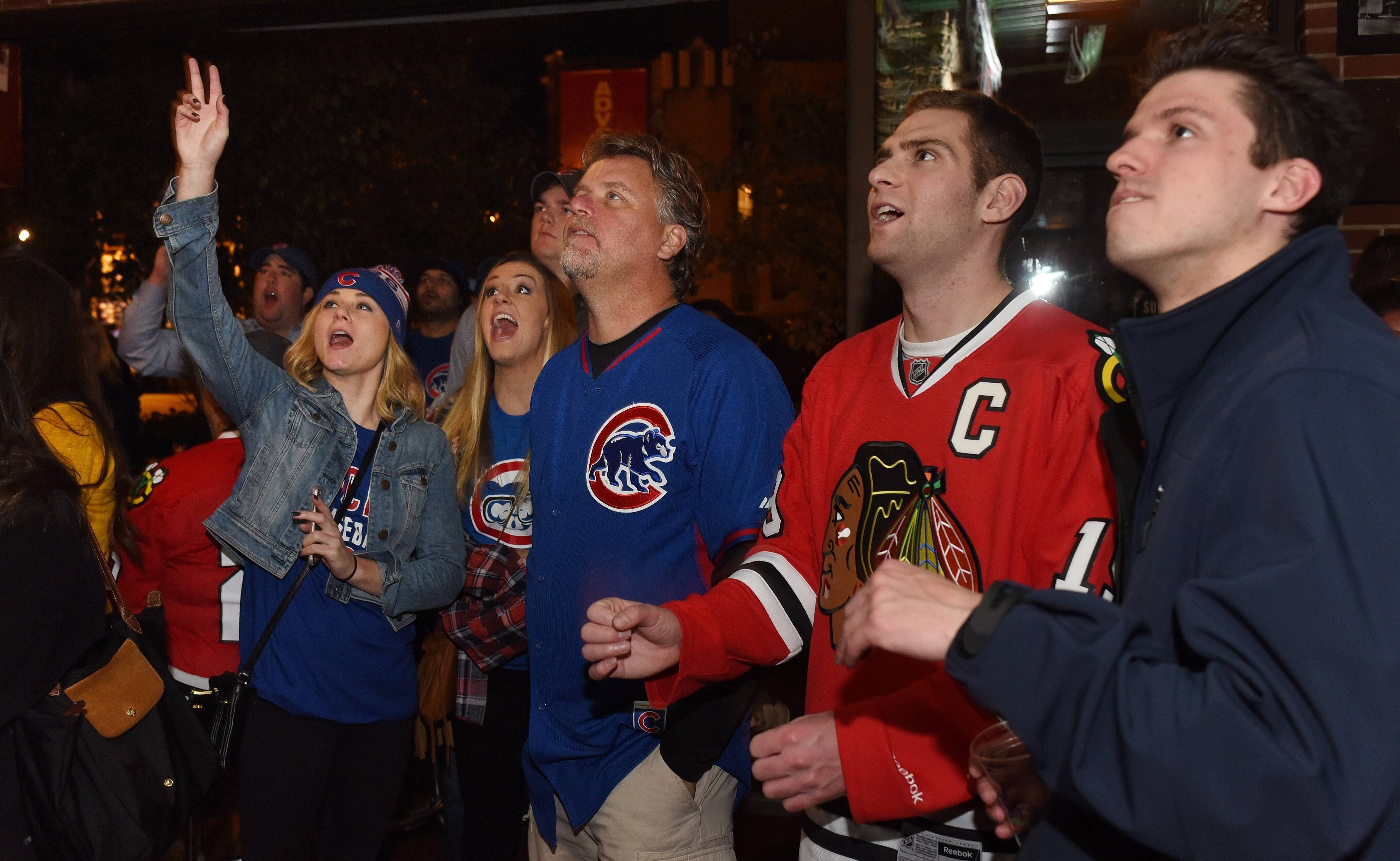 Fans celebrate outside Wrigley Field following the Cubs' win over the Pirates in the National League Wild Card game Wednesday. Crowds are expected to be even larger Monday, when the team takes on archrival St. Louis in the playoffs.