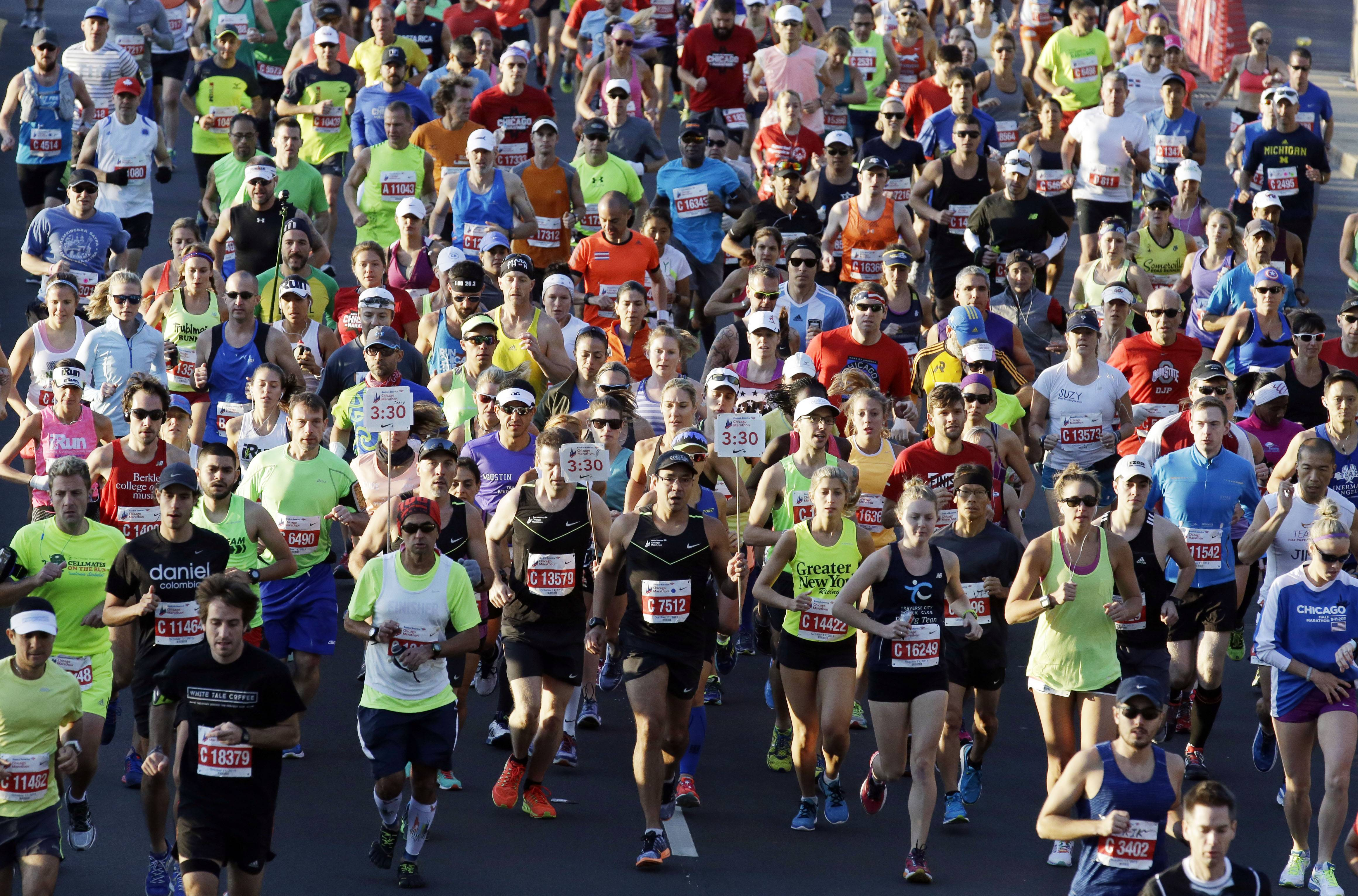 Runners participate in the Chicago Marathon, Sunday, Oct. 11, 2015, in Chicago.