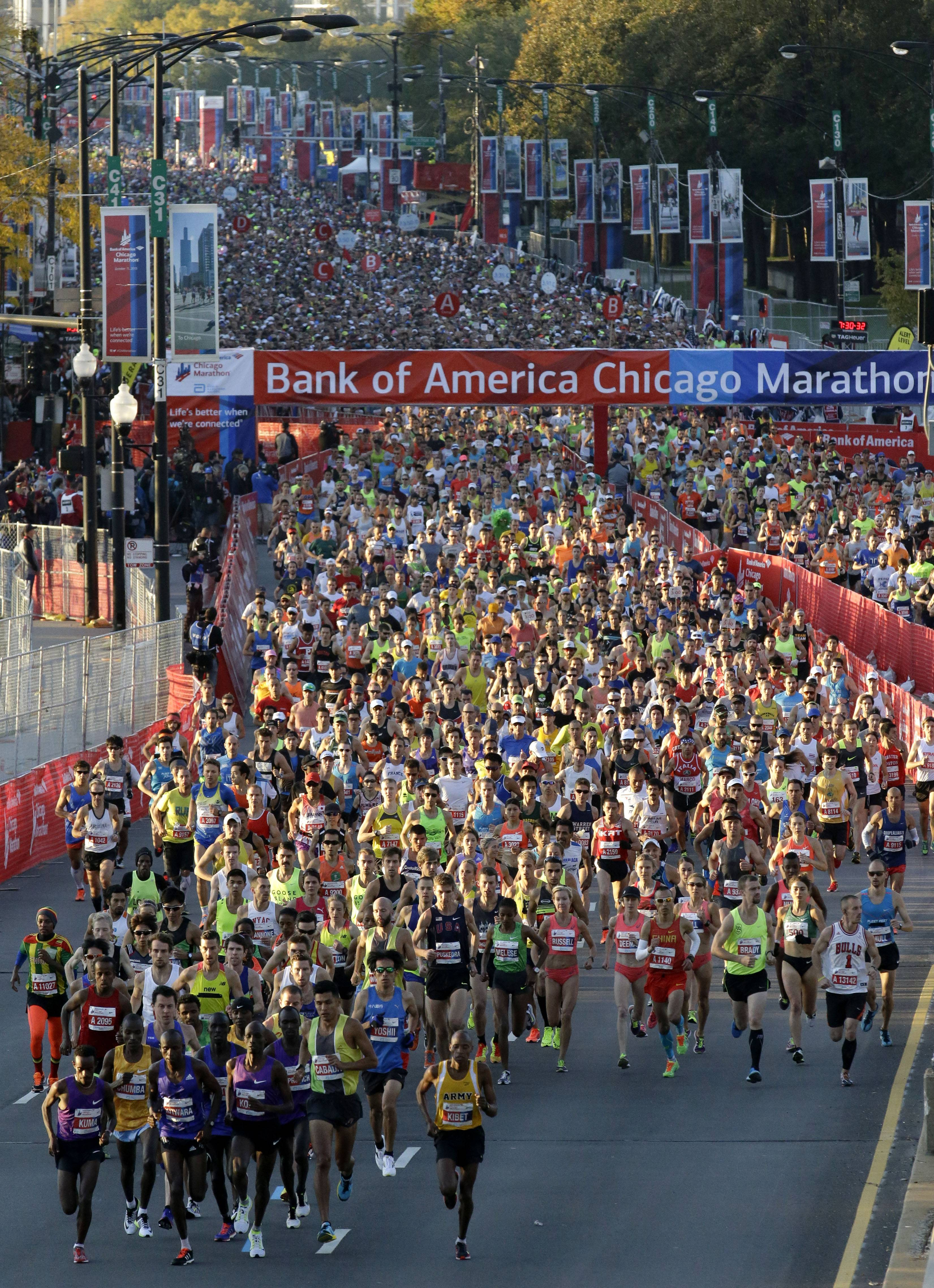 Runners start the Chicago Marathon, Sunday, Oct. 11, 2015, in Chicago.