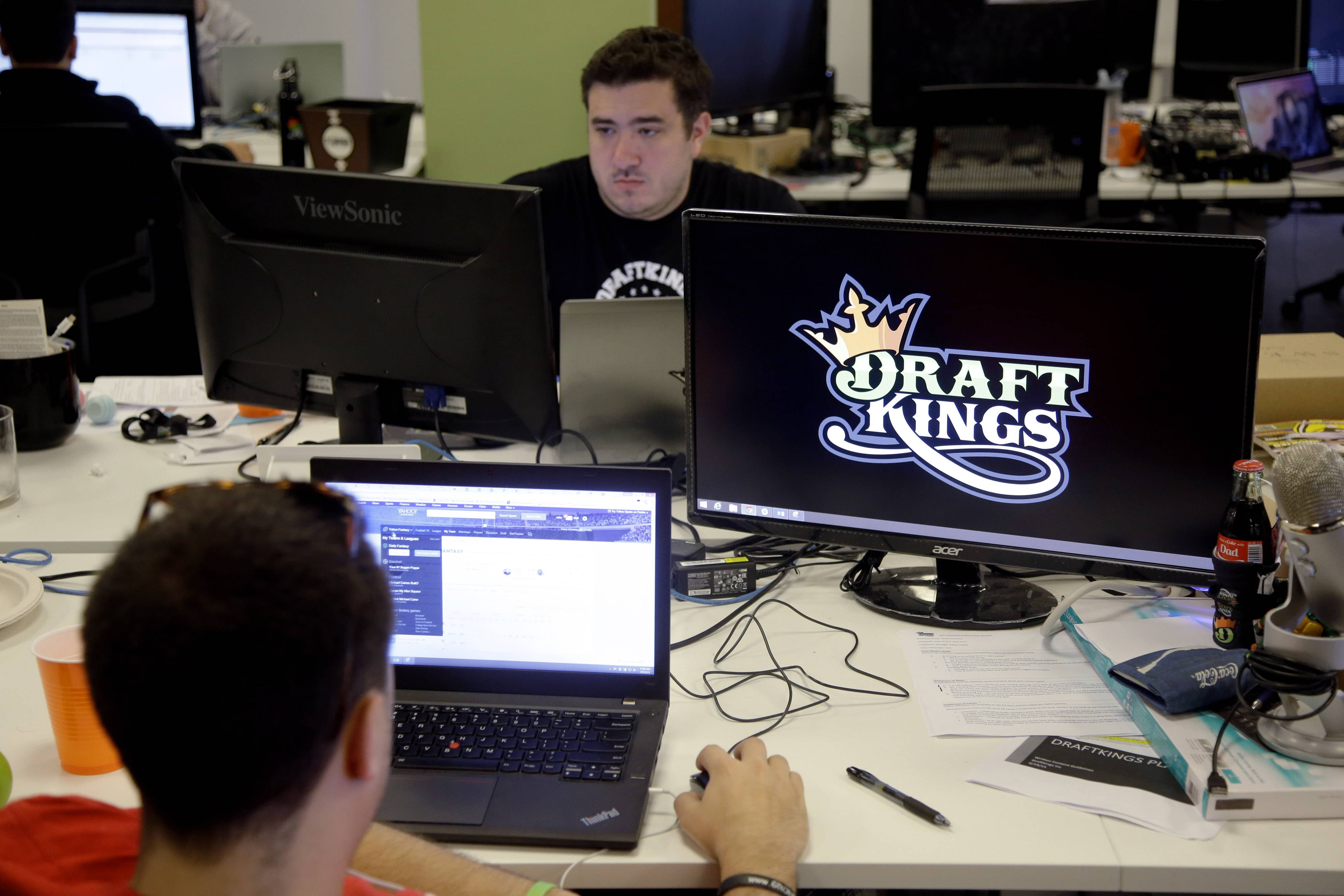 FILE- In this Sept. 9, 2015, file photo, Len Don Diego, marketing manager for content at DraftKings, a daily fantasy sports company, works at his station at the company's offices in Boston. The daily fantasy sports industry is eyeing a breakout season as NFL games begin. And its two dominant companies, DraftKings and FanDuel, are touting lucrative opening week prizes to try to draw more customers as more competitors pop up.