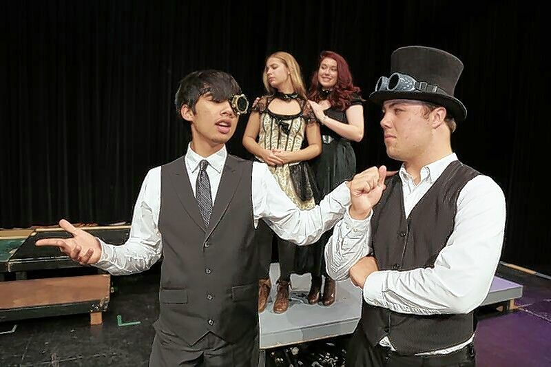 Lord Capulet, played by Cole Keller, left, speaks with Friar Laurence, played by Nate Carlson, right, about arranging the marriage of Juliet, played by Natalie Antonik, back left, who stands with Lady Capulet, Teagan Capek.