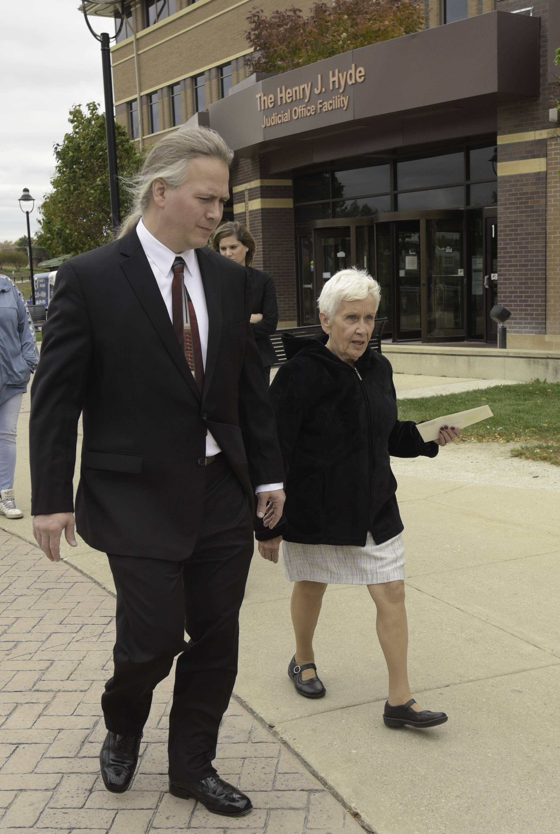 Bill and Sandy Wesselman, the brother and mother of Kristy Wesselman, leave the DuPage County Courthouse Tuesday morning after Michael Jones pleaded not guilty to Kristy's 1985 murder.