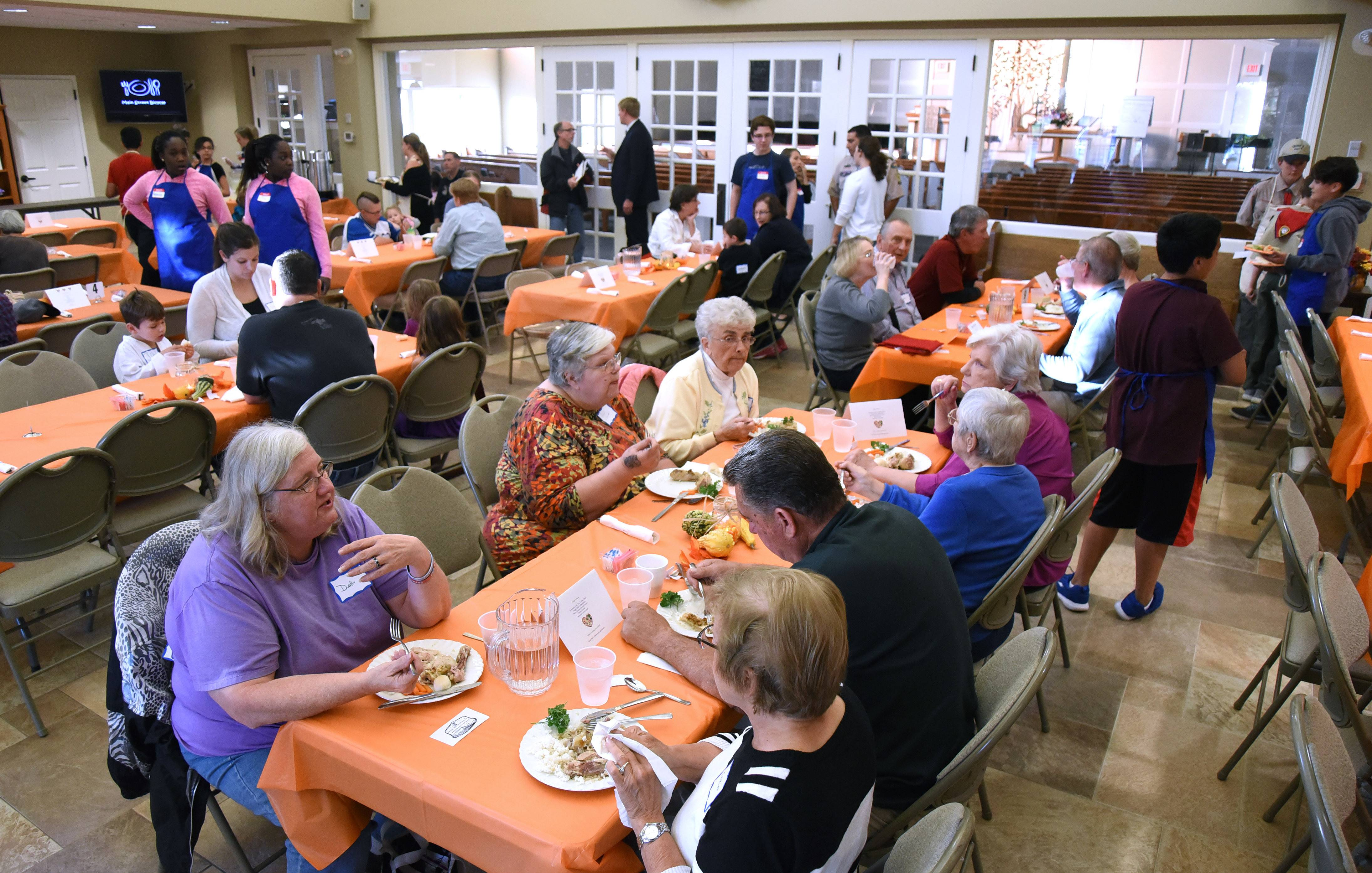 Inspired by free community meals served by churches in Geneva, Batavia and St. Charles, First Congregational Church of Dundee hosted its first Hilltop Community Supper on Tuesday in West Dundee.