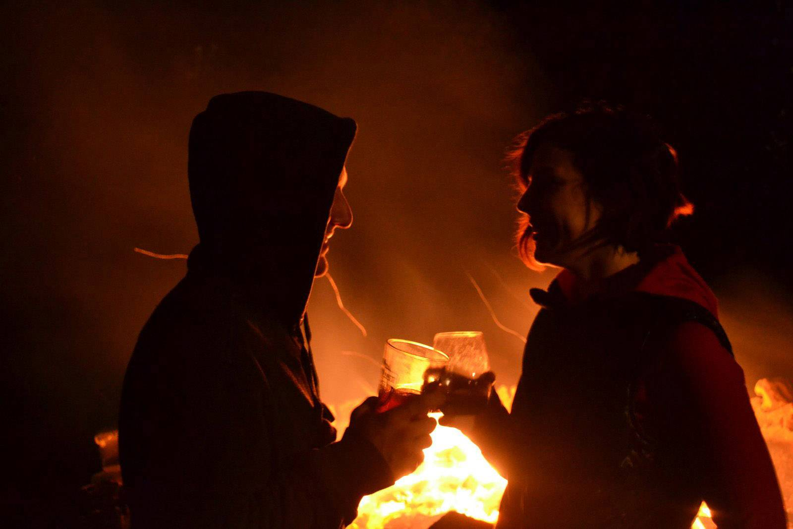 Krista Hook and Ron Heslop enjoy the warmth of a bonfire in Lake Villa on Oct. 4.