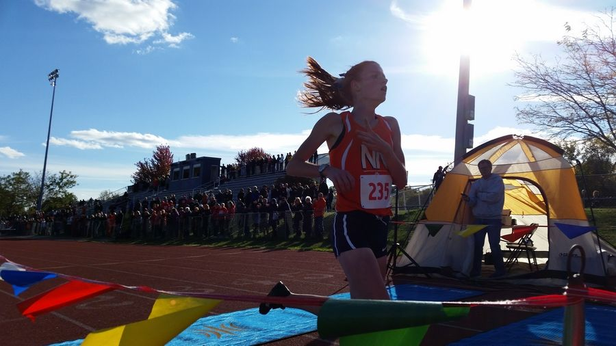 Naperville North's Judy Pendergast wins the DuPage Valley Conference girls cross country race in record time Friday at Lake Park.
