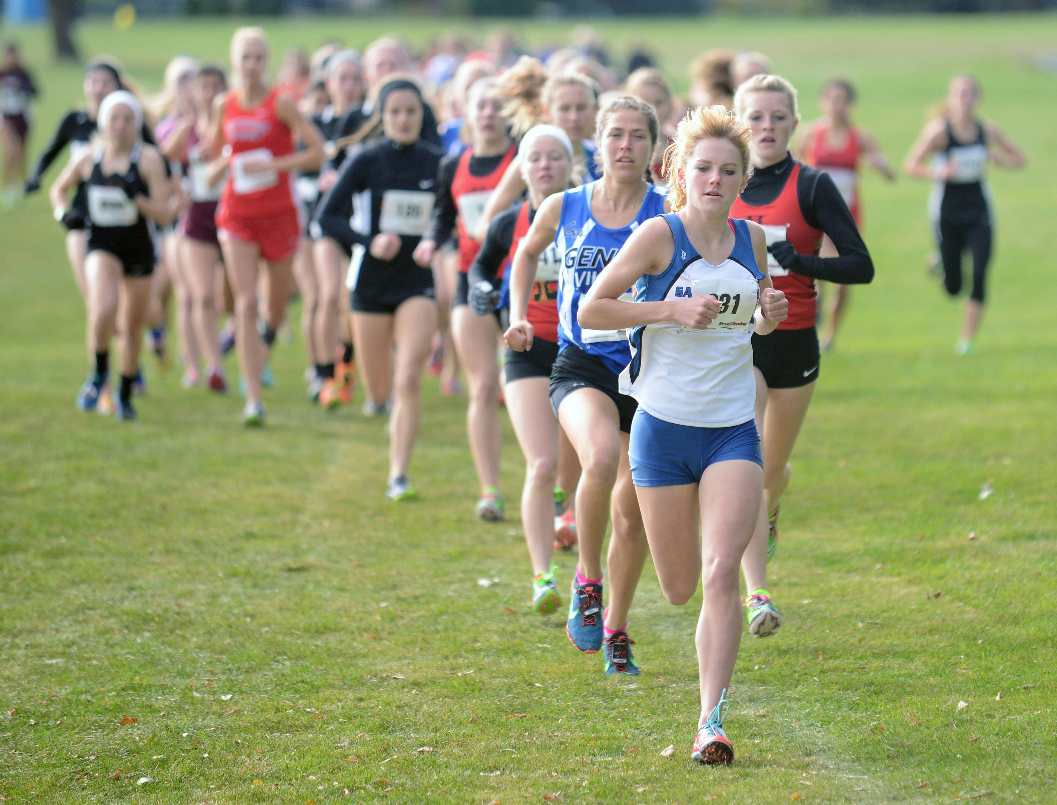 St. Charles North's Audrey Ernst leads the girls varsity race early in the Upstate Eight cross country meet at Sunrise Park in Bartlett Saturday.