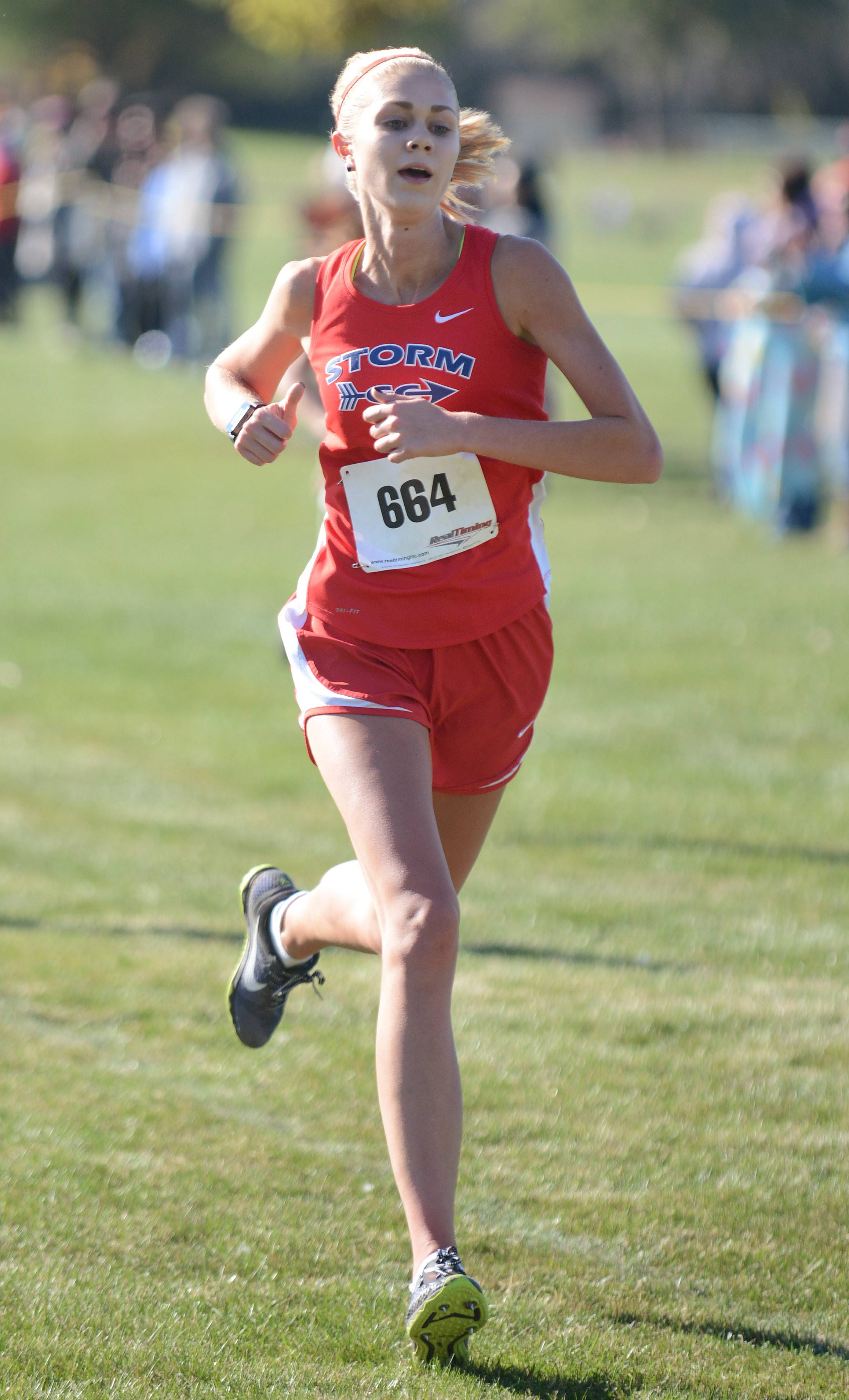 South Elgin's Sam Czuprynski comes in first for her team in the girls varsity race in the Upstate Eight cross country meet at Sunrise Park in Bartlett Saturday.