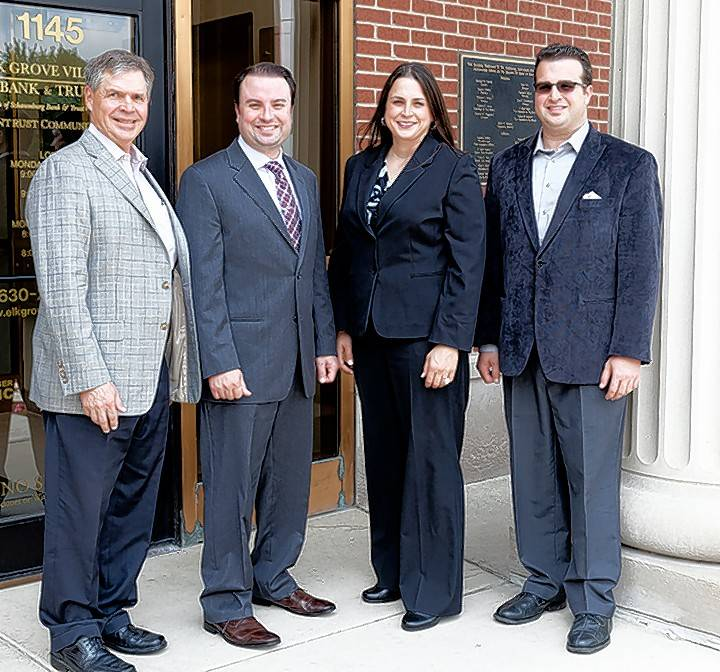 Former ARO Metal Stamping Inc. owner Tony Dupasquier, from left, Aaron Wiegel, Erica Wiegel and Ryan Wiegel mark Erica's ownership of Aro in July. Aro does metal stamping for the aerospace, defense and automotive industries.