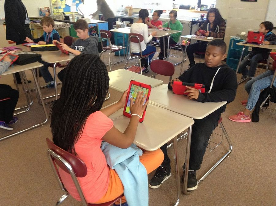 Students use their iPads in Beth Tiglas' sixth-grade math class at Viking Middle School in Gurnee. Gurnee Elementary District 56's iPad initiative has helped it gain admission to a select nationwide organization focused on digital learning.