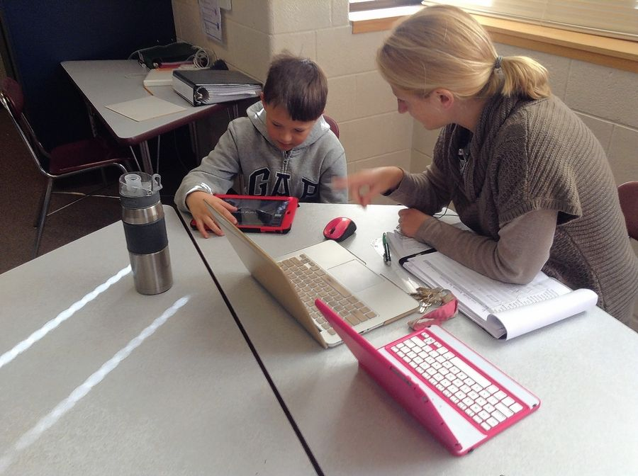 Teacher Beth Tiglas helps a sixth-grade student in her mathematics class at Viking Middle School in Gurnee. Gurnee Elementary District 56's iPad initiative has helped it gain admission to a select nationwide organization focused on digital learning.