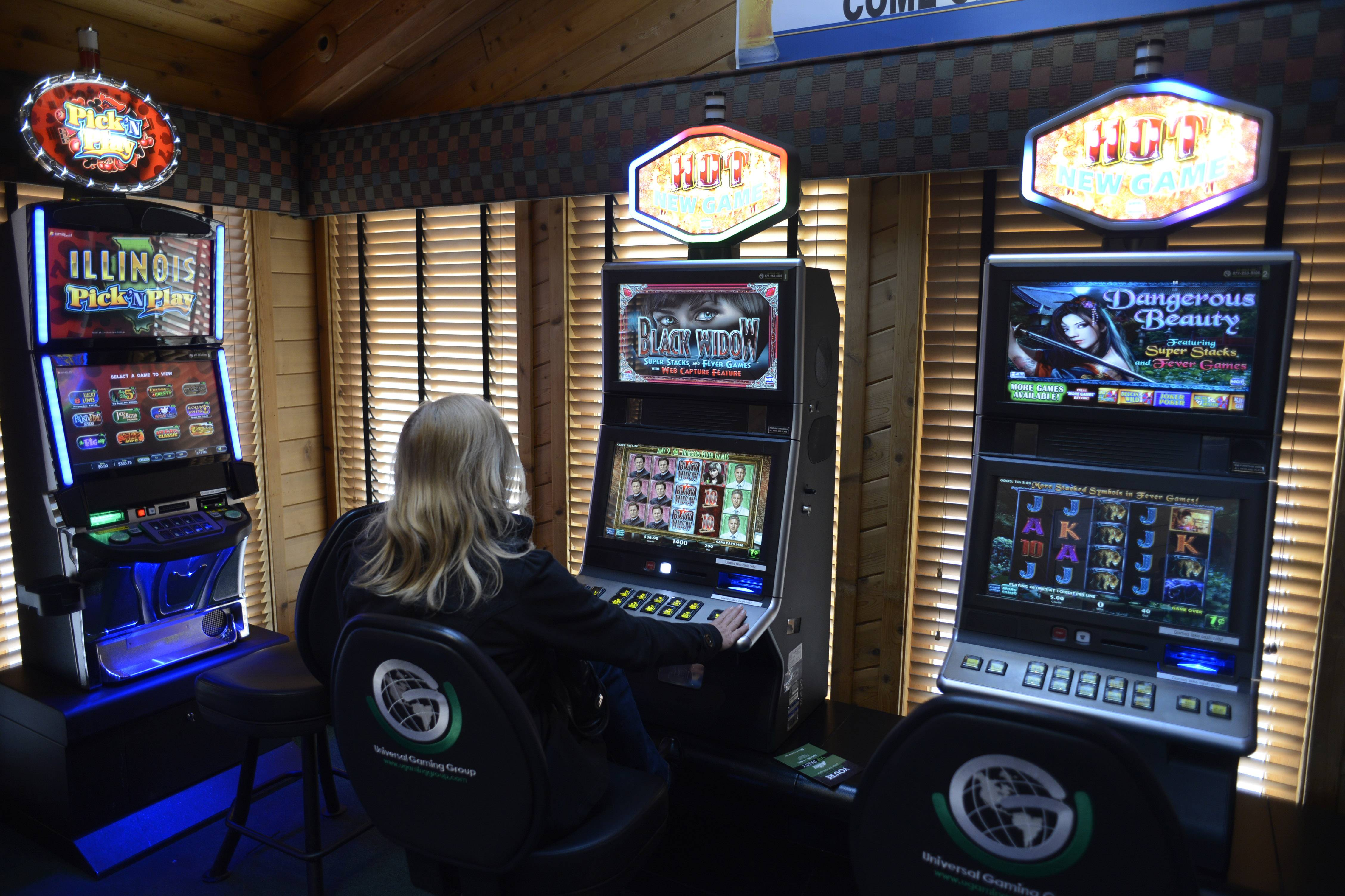 A patron plays a video gambling machine at The Assembly in Hoffman Estates.