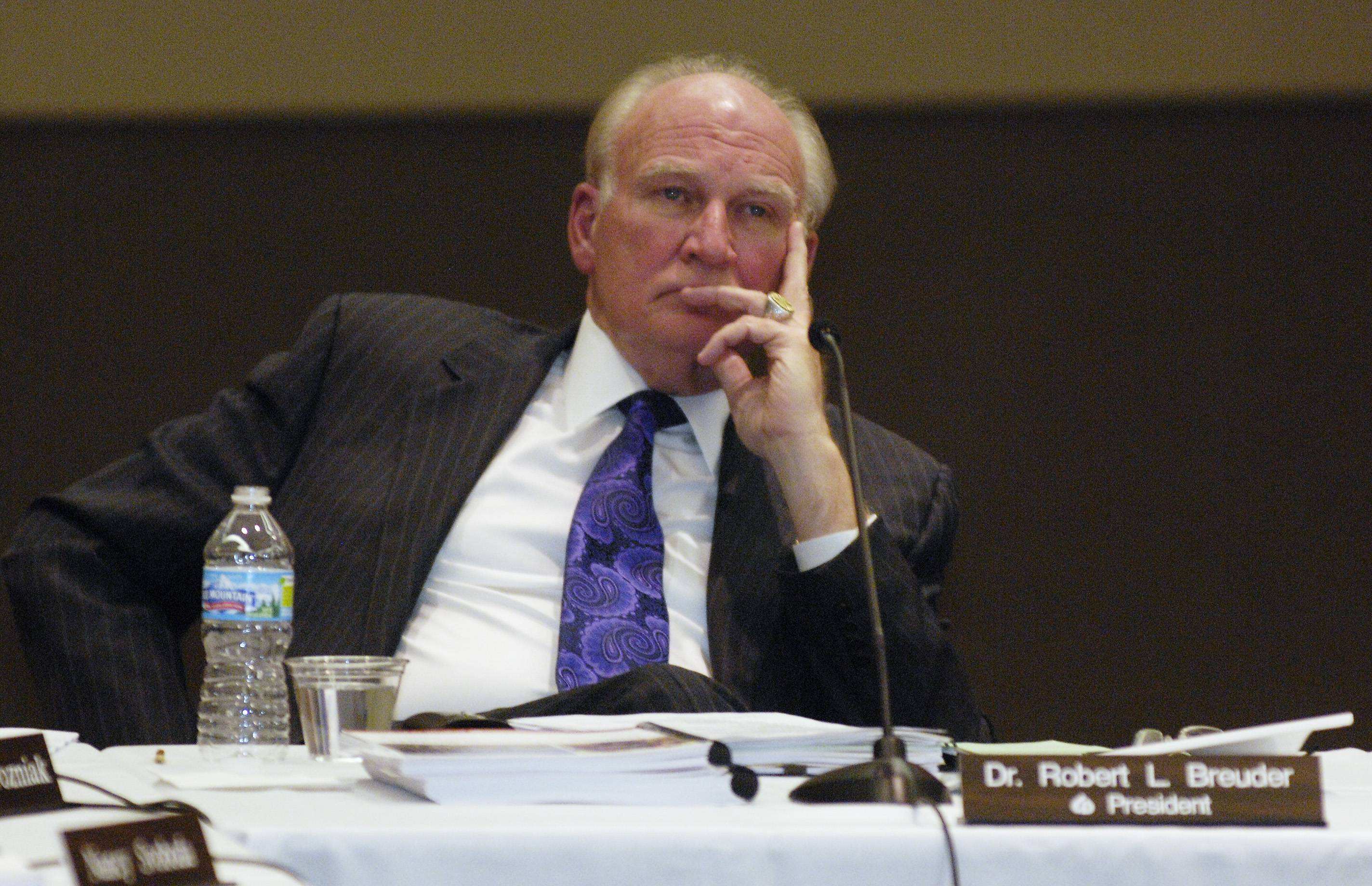 Robert Breuder was fired Tuesday night as president of the College of DuPage when the school's board of trustees voted on a resolution to terminate him.