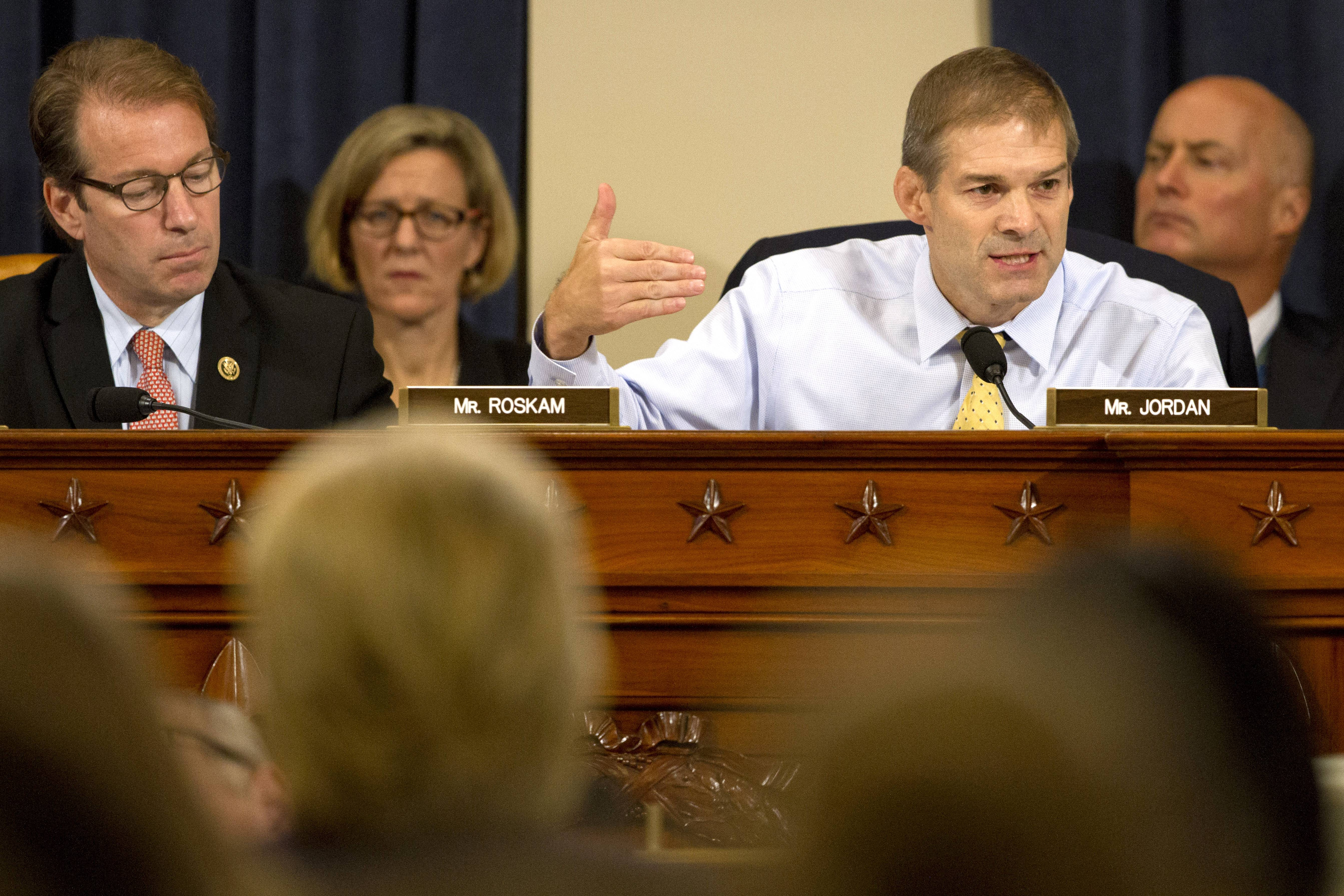 Republican Reps. Jim Jordan of Ohio, right, and Peter Roskam of Wheaton question Democratic presidential candidate and former Secretary of State Hillary Rodham Clinton as she testifies before the House Benghazi Committee.