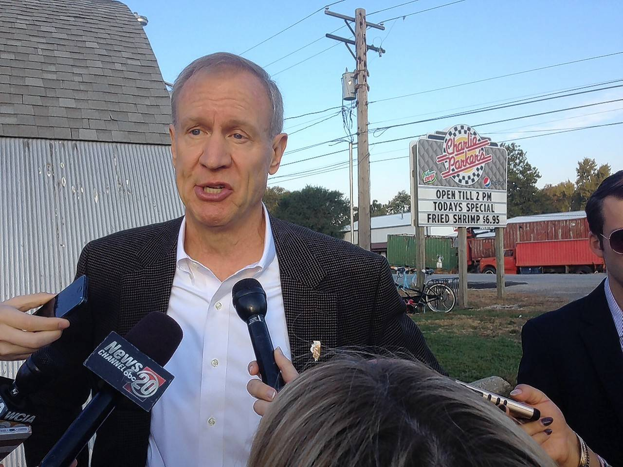 Gov. Bruce Rauner, during an event at a Springfield diner, responded to criticism from former Republican governors.