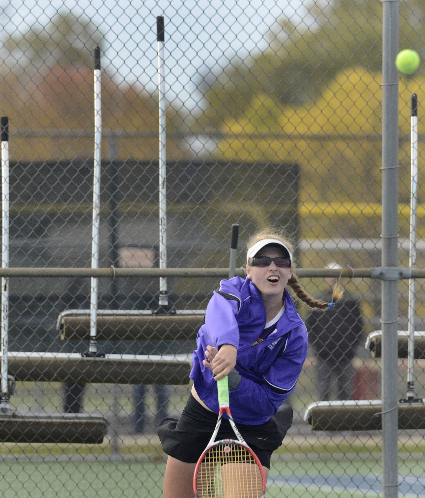 Sarah Hackman of Wauconda returns a shot form Mackenzie Beckham of Whitney Young during first-round action of the girls tennis state tournament at Palatine High School.