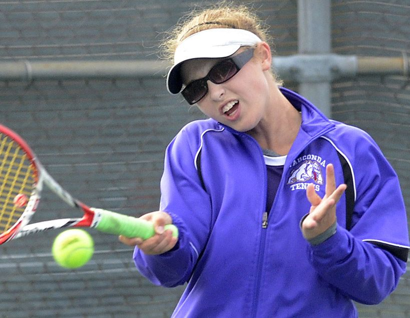 Sarah Hackman of Wauconda returns a shot from Mackenzie Beckham of Whitney Young during first-round action of the girls tennis state tournament at Palatine High School.