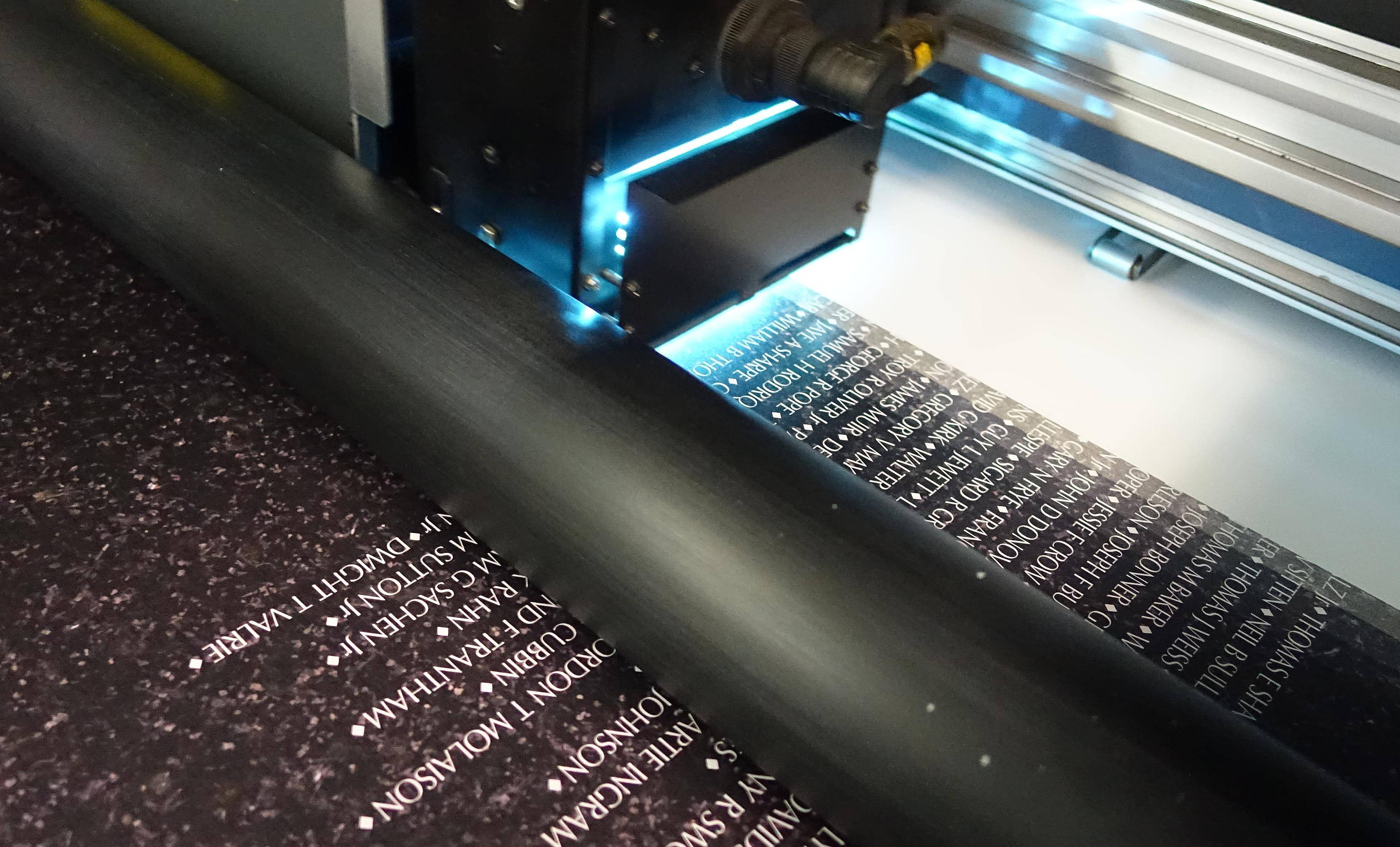 Blooming Color's printing center in Lombard uses a special inkjet printer with UV lights to print a replica of the Vietnam Wall memorial. The finished product will stand up to the elements when on display outdoors Nov. 6 through 12 at Naperville's Healing Field of Honor.