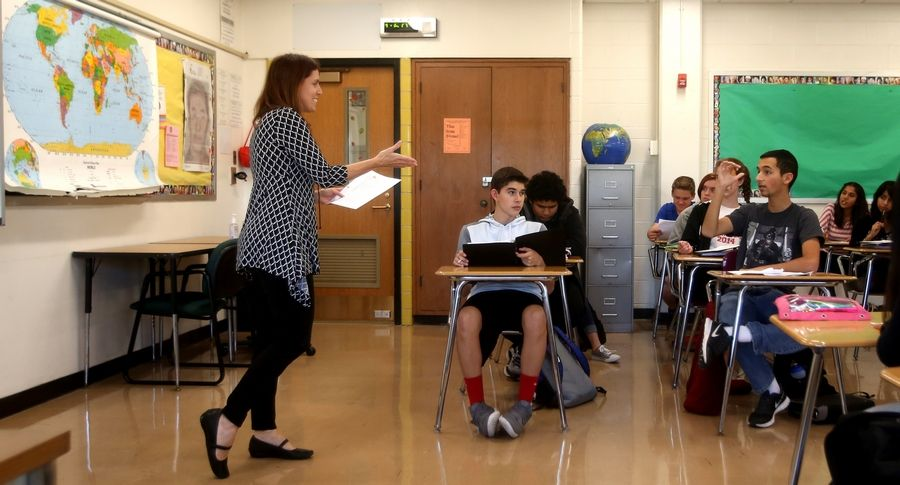 Laura Broderick, left, leads an AP Human Geography class at Glenbard East High School in Lombard. The district has doubled the number of students taking AP exams since 2007.