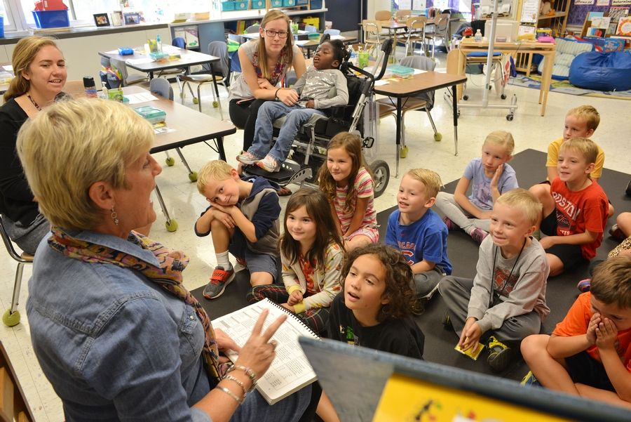 First-grade teacher Beth Gunther, left foreground, teaches a reading lesson at Emerson School in Wheaton.