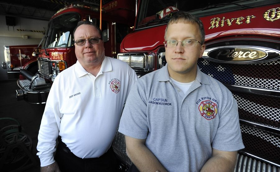 Fox River Grove Fire Capt. Jason Kedrok, right, talks with Fire Chief Bob Kreher about the Oct. 25, 1995, school bus and train accident. Kreher was on the scene and Kedrok was a student on the bus.