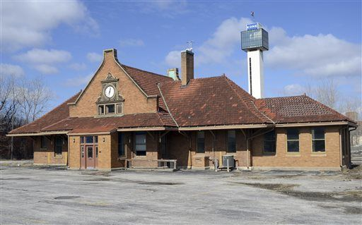 This March 12, 2014 photo shows the 115-year-old train depot in Moline, Ill. The Illinois Department of Transportation says the depot will be demolished in the summer of 2016. The department said in a letter to Moline Historic Preservation commissioner Barb Sandberg that it wouldn't pay to move the depot because of budget cuts and added costs tied to the Interstate 74 bridge and corridor project. (Todd Mizener/The Dispatch via AP)