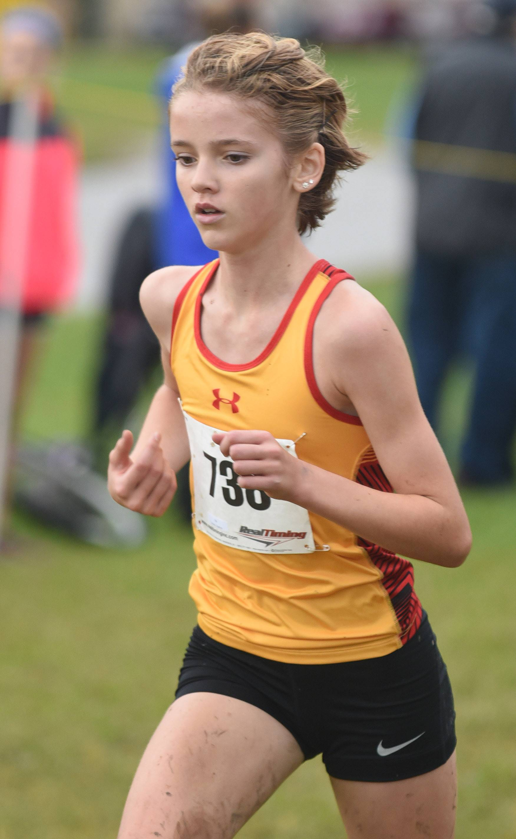 Batavia's Daphne Kolody takes fourth place (and second for her team) in the girls varsity race with a time of 18:50.5 at the St. Charles North cross country regional on Saturday.